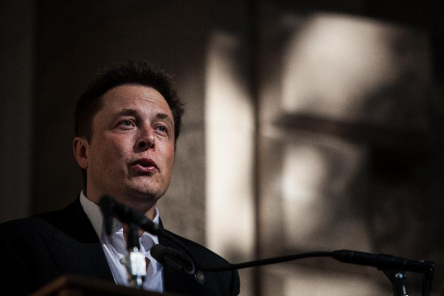 Tesla Motors shares raced higher after founder Elon Musk tantalized fans via Twitter with a hint the electric carmaker will unveil a new model next week