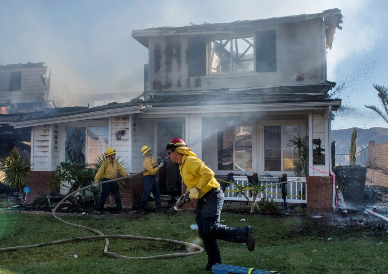 Firefighters battle fierce wildfires across California