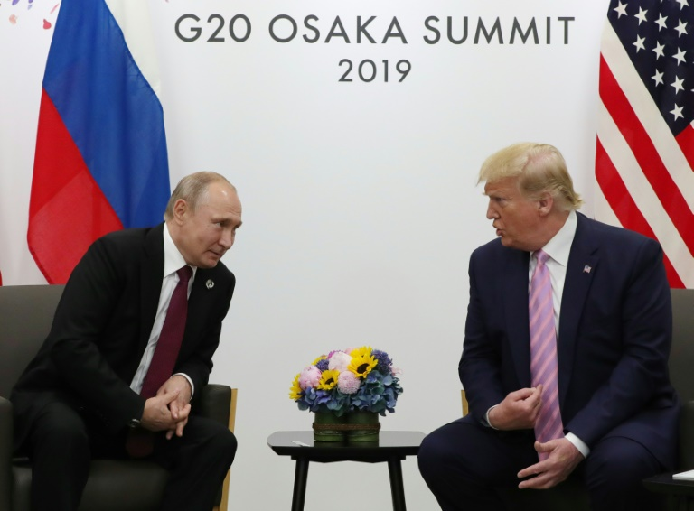 With a smile, Trump tells Putin dont meddle in the election
