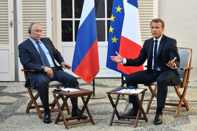 Macron, Putin see chance on Ukraine but clash on Syria
