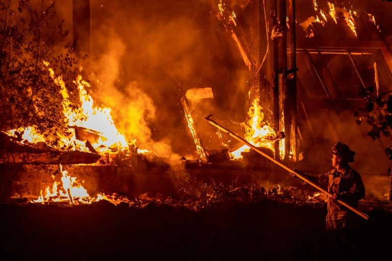 California fires: warnings for Los Angeles, progress up north