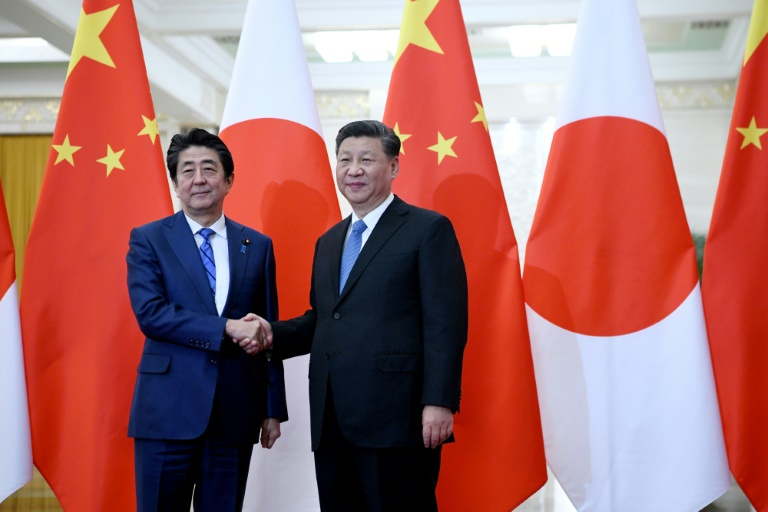 Japans Abe urges Hong Kong freedoms in Xi meeting