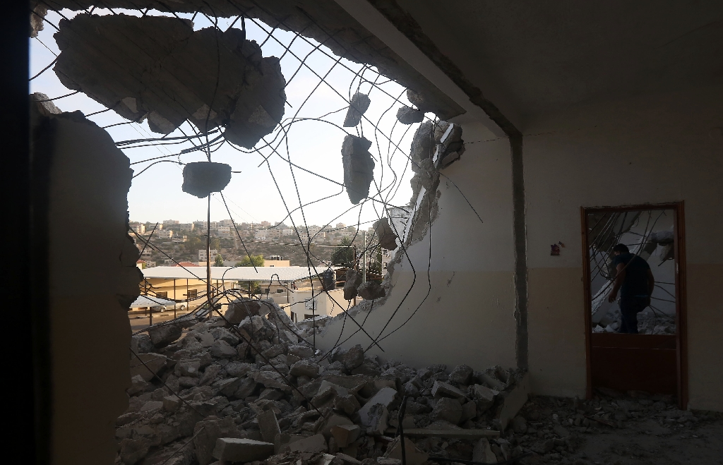 Israel destroys home of Palestinian accused after deadly attack