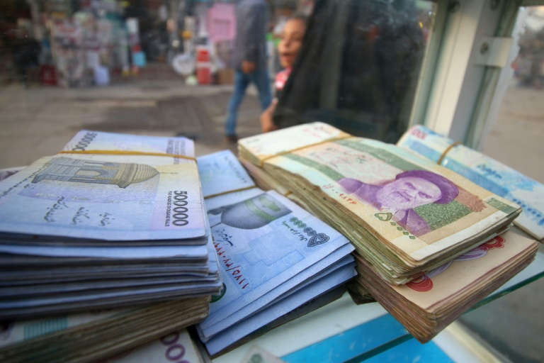 Sanctions-hit Iran to cut zeros and rename plunging currency