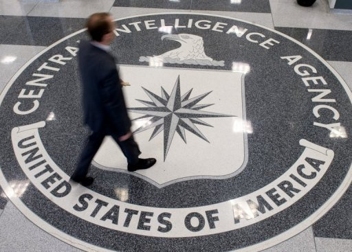A man crosses the Central Intelligence Agency (CIA) logo in the lobby of CIA Headquarters in Langley, Virginia. The man ordered by Al-Qaeda's branch in Yemen to blow up a US-bound airliner was a double agent who infiltrated the group and volunteered for the suicide attack, US media reported Tuesday. (AFP Photo/Saul Loeb)