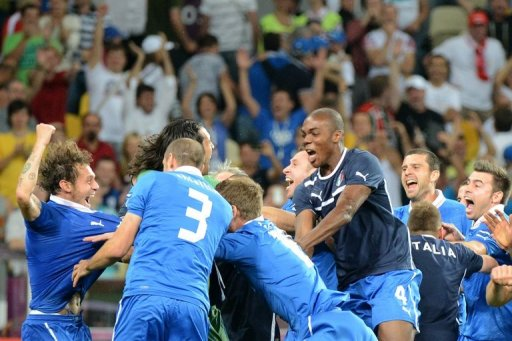 Italian players celebrate after winning their Euro 2012 quarterfinal against England. (AFP)