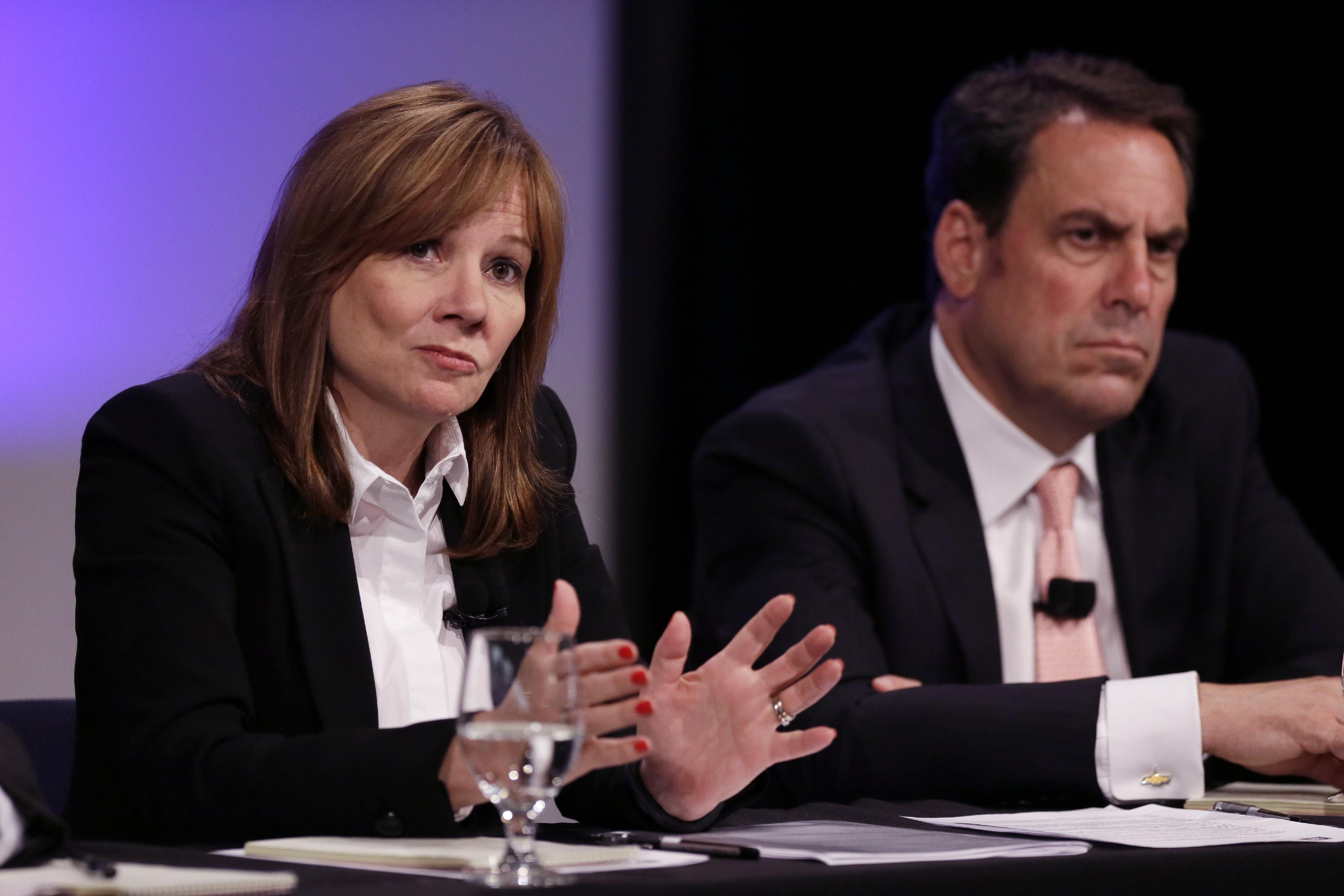 General Motors CEO Mary Barra, and Executive Vice President Mark Reuss are seen during a press conference at the General Motors Technical Center in Warren, Mich., Thursday, June 5, 2014. They talked about the results released by an outside attorney's investigation why it took the company a decade to disclose a defect in small cars that is now linked to 13 deaths. (AP Photo/Carlos Osorio)