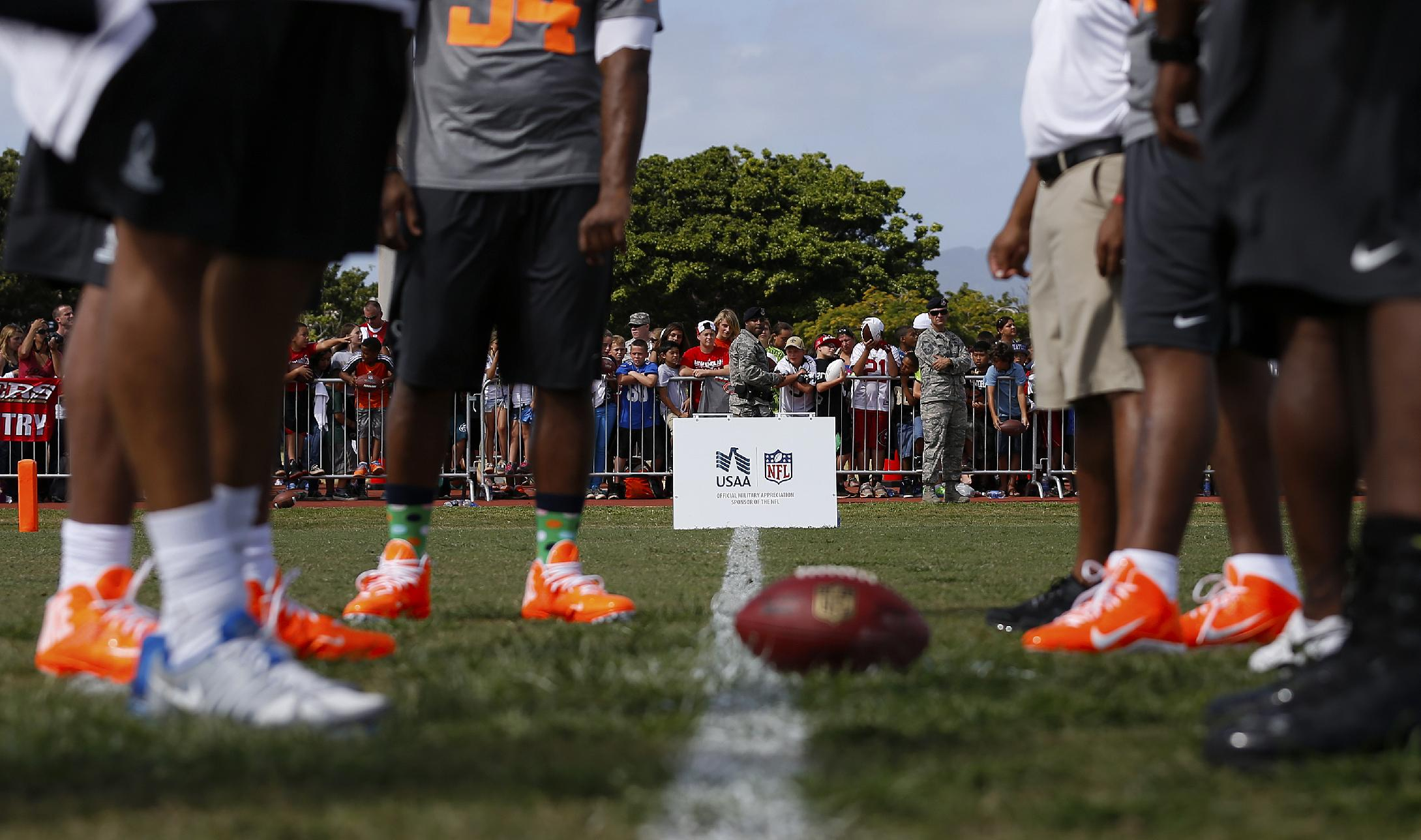 NFL Pro Bowl players from Team Rice gather on the line of scrimmage during an NFL Pro Bowl practice on Earhart Field at Joint Base Pearl Harbor-Hickam sponsored by the USAA the official military sponsor of the NFL on Thursday January 23, 2014 in Honolulu, Hawaii. (Aaron M. Sprecher/AP Images for USAA)