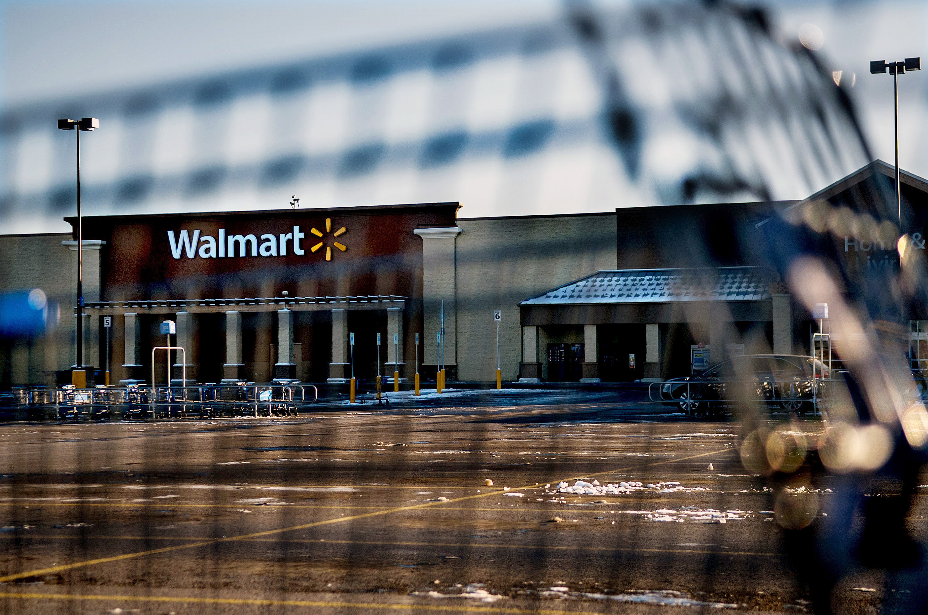 This photo shows Wal-Mart with a shopping cart in the foreground in Hayden, Idaho, Tuesday, Dec. 30, 2014. A 2-year-old boy accidentally shot and kill...