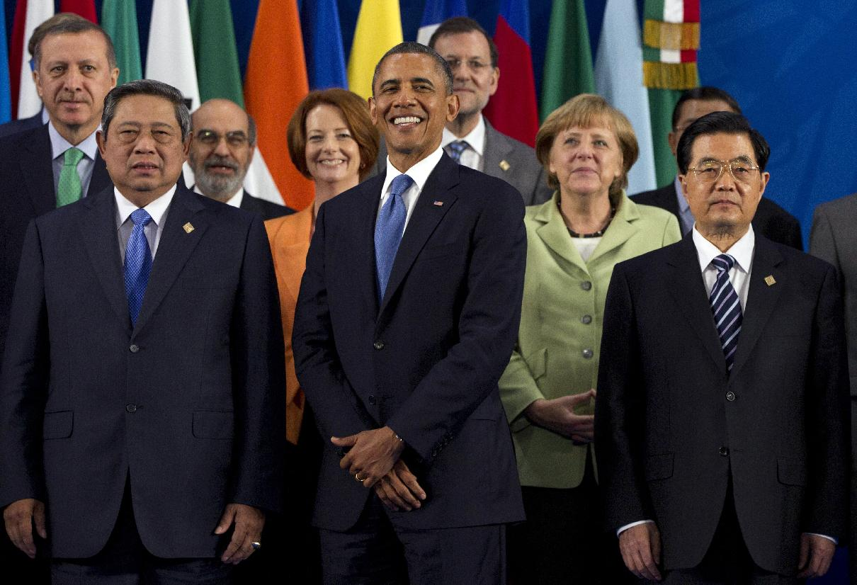President Barack Obama takes his place with other leaders for the Family Photo during the G20 Summit, Monday, June 18, 2012, in Los Cabos, Mexico. (AP Photo/Carolyn Kaster)