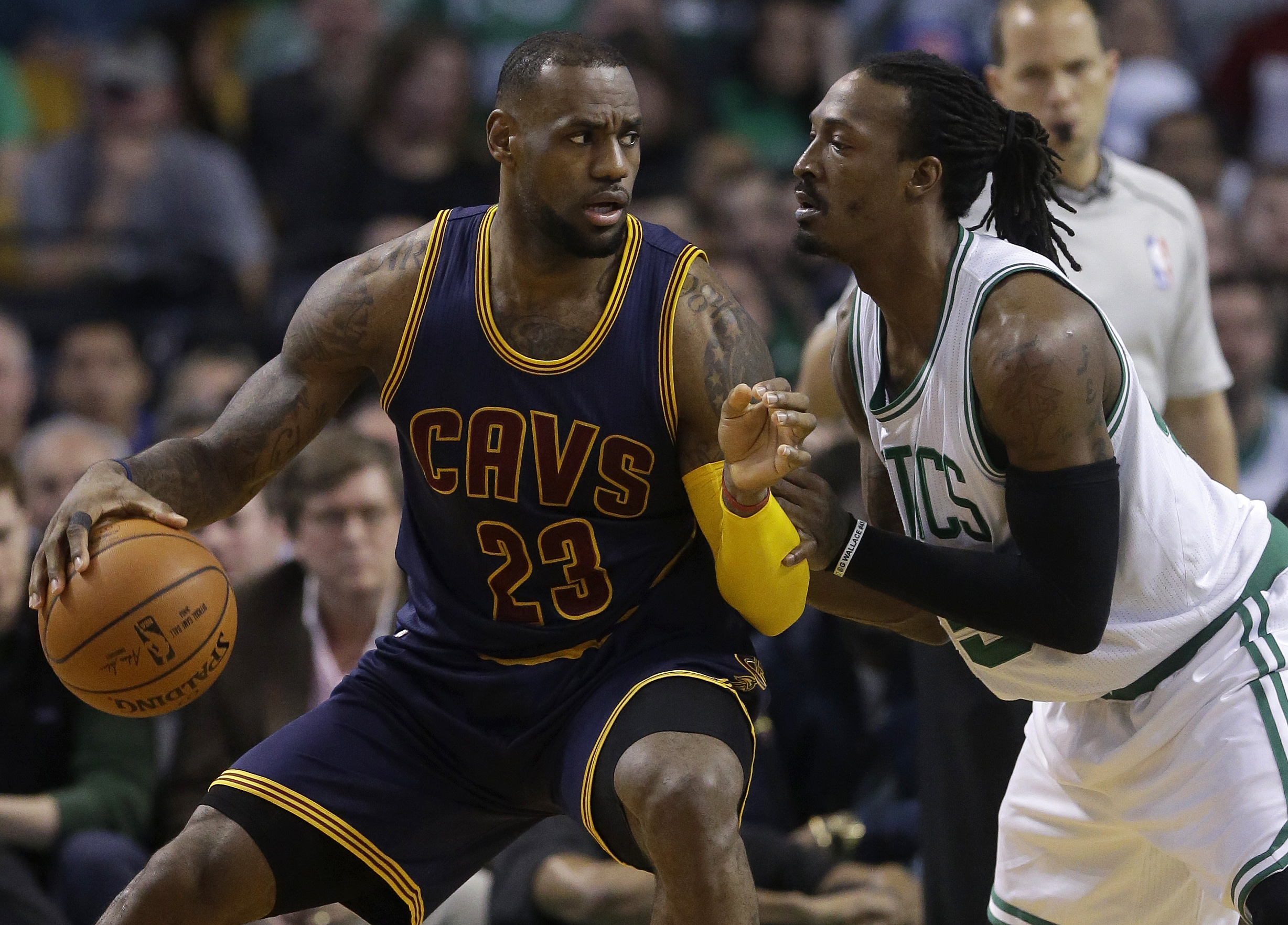 Cleveland Cavaliers forward LeBron James, left, looks for an opening around Boston Celtics forward Gerald Wallace, right, in the second quarter of a first-round NBA playoff basketball game in Boston, Sunday, April 26, 2015. The Cavaliers won 101-93 to complete a first-round sweep of the Celtics. (AP Photo/Steven Senne)