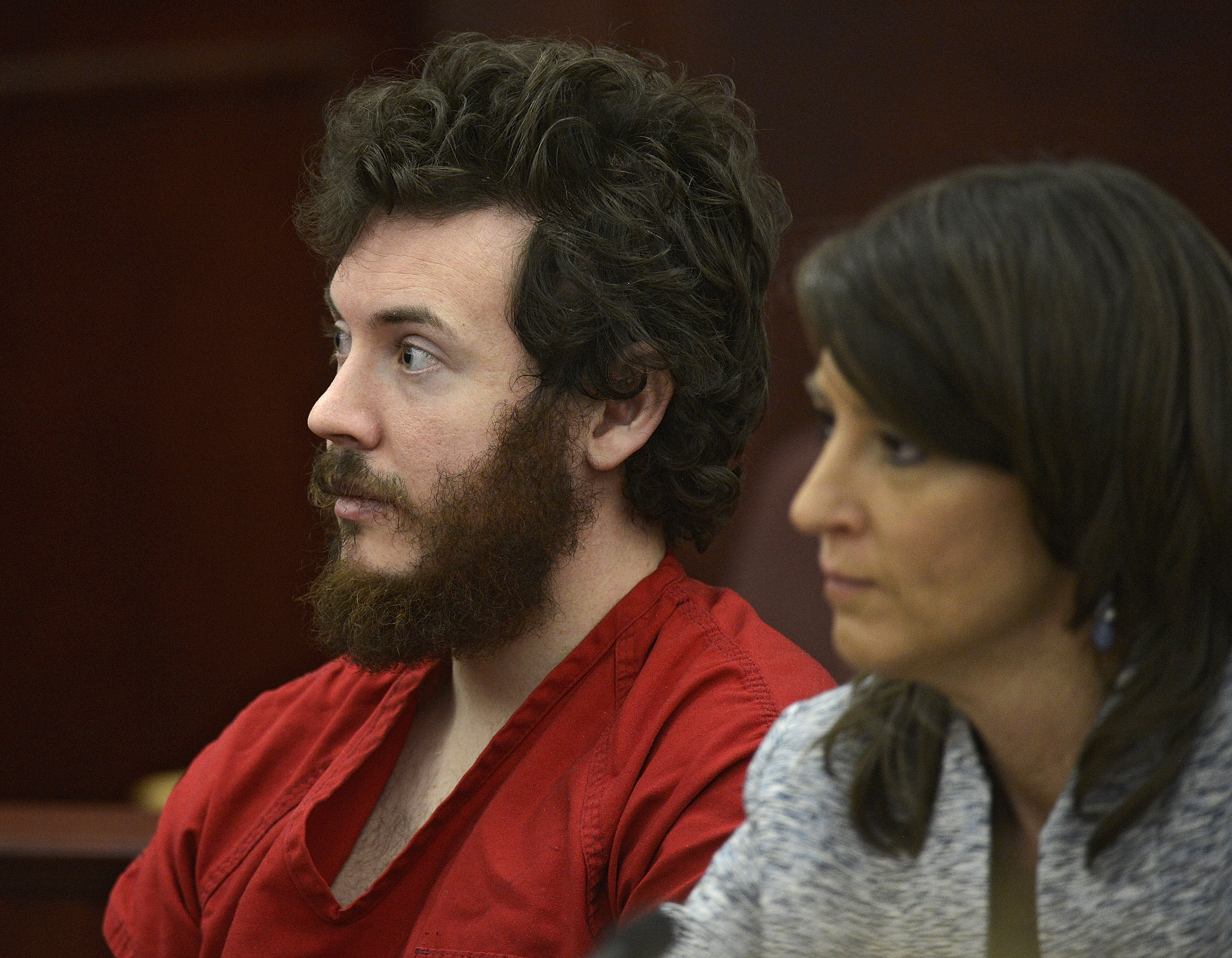 The Latest: James Holmes says God would care about shootings