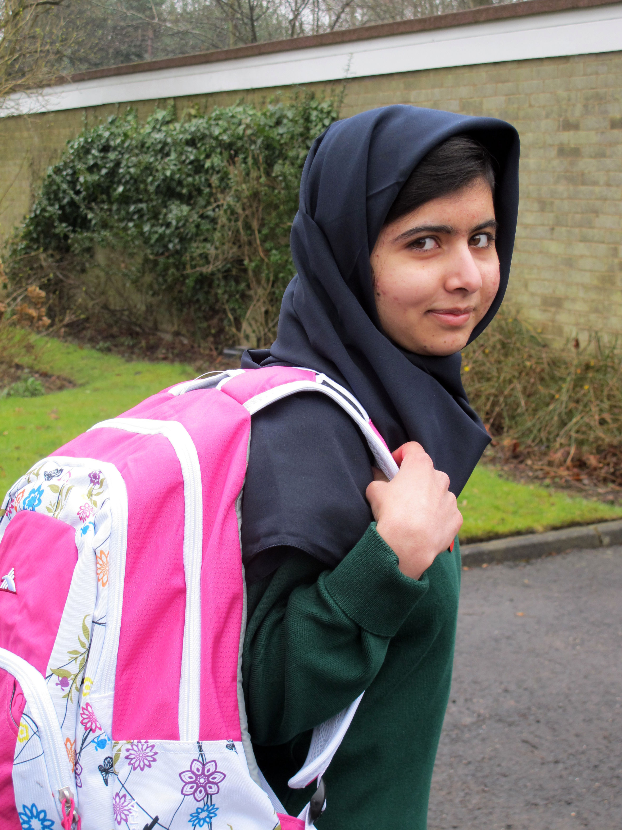Image made available by her press office of Malala Yousafzai, the Pakistani schoolgirl shot in the head by the Taliban, as she attends her first day of school on Tuesday March 19, 2013 just weeks after being released from hospital. The 15-year-old participated in lessons at the Edgbaston High School for Girls in Birmingham, central England. She survived an assassination attempt by the fundamentalist political group in October last year and underwent hours of surgery in the UK to try and repair the damage caused by a bullet which grazed her brain. (AP Photo/ Malala Press Office)