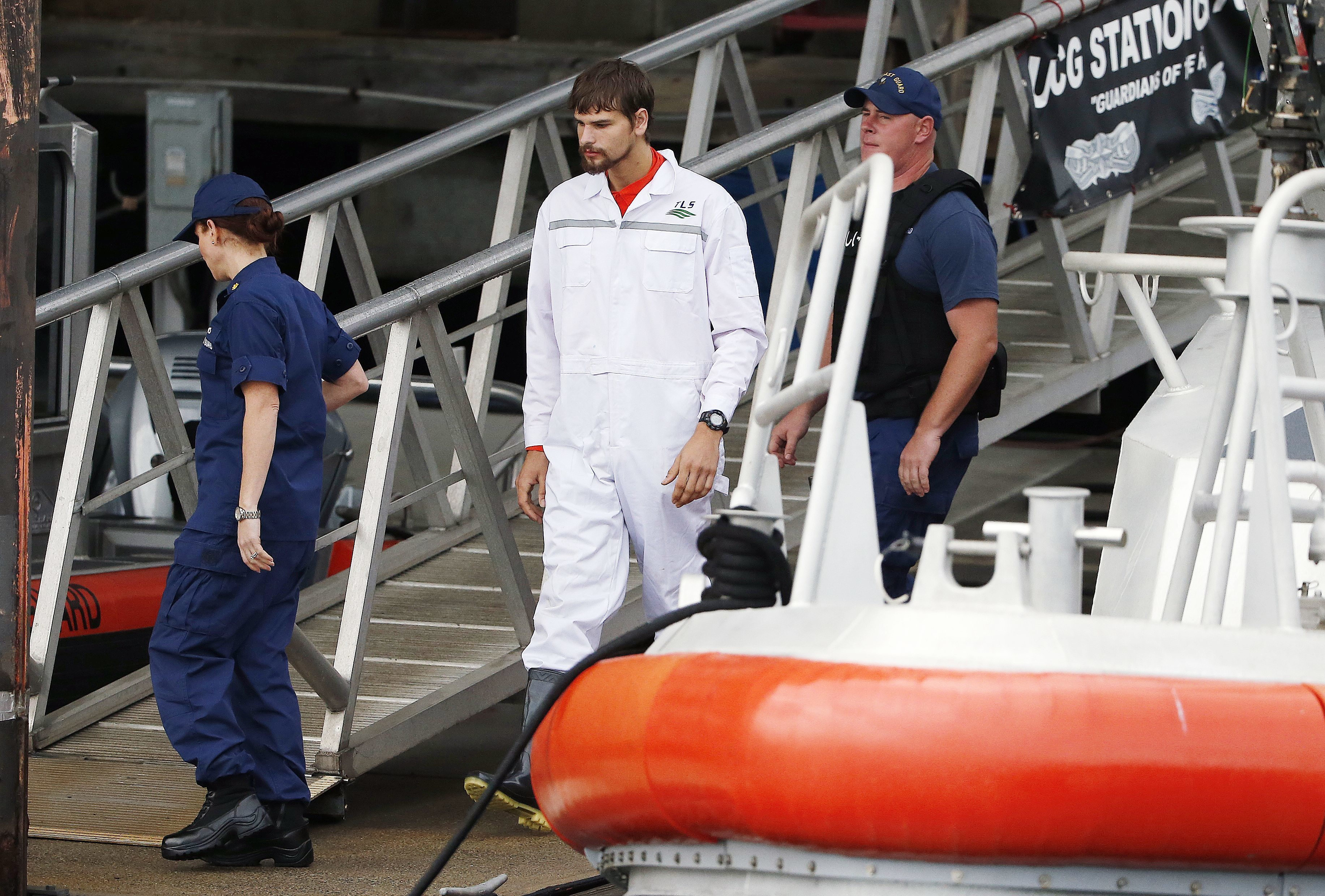The Latest: Coast Guard releases phone call with rescued man