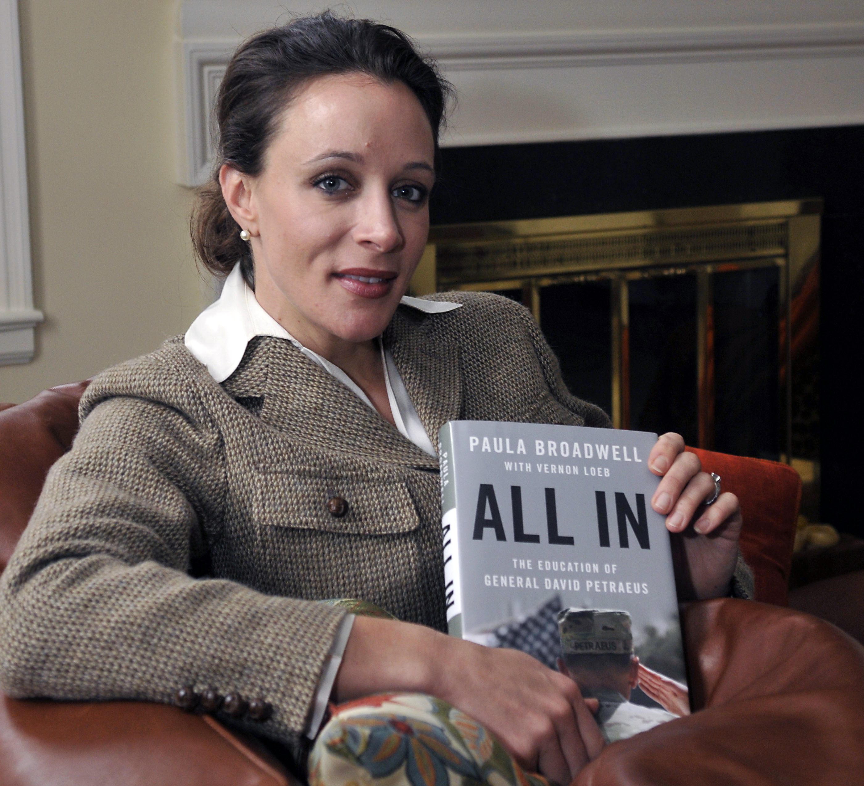 """In this Jan. 15, 2012 photo, Paula Broadwell, author of the David Petraeus biography """"All In,"""" poses for photos in Charlotte, N.C. Petraeus, the retired four-star general renowned for taking charge of the military campaigns in Iraq and then Afghanistan, abruptly resigned Friday, Nov. 9, 2012 as director of the CIA, admitting to an extramarital affair. Petraeus carried on the affair with Broadwell, according to several U.S. officials with knowledge of the situation. (AP Photo/The Charlotte Observer, T. Ortega Gaines) LOCAL TV OUT (WSOC, WBTV, WCNC, WCCB); LOCAL PRINT OUT (CHARLOTTE BUSINESS JOURNAL, CREATIVE LOAFLING, CHARLOTTE WEEKLY, MECHLENBURG TIMES, CHARLOTTE MAGAZINE, CHARLOTTE PARENTS) LOCAL RADIO OUT (WBT)"""