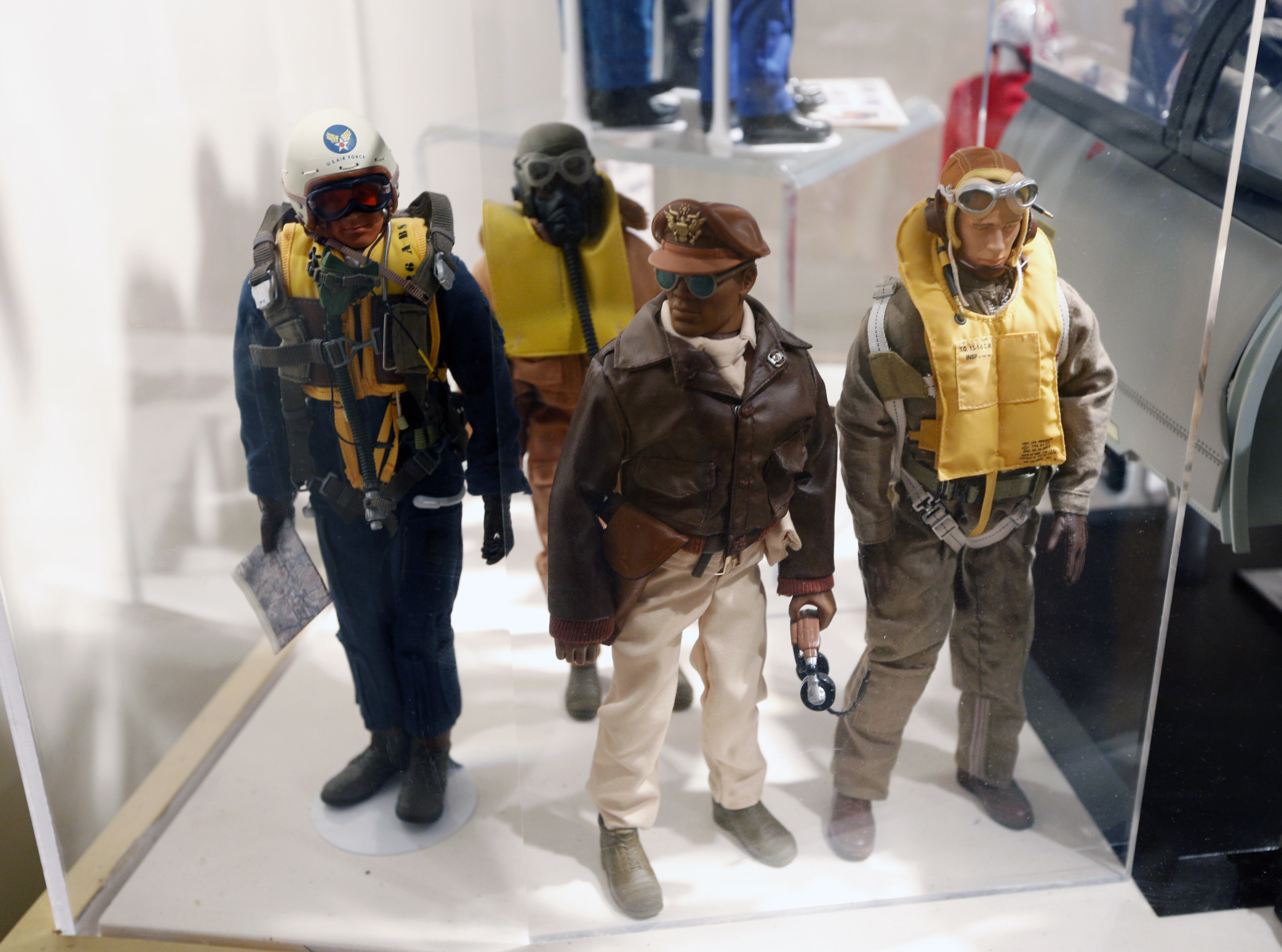 This Jan. 31, 2014 photo shows Tuskegee Airmen G.I. Joe action figures in a display at the New York State Military Museum in Saratoga Springs, N.Y. A half-century after the 12-inch doll was introduced at a New York City toy fair, the iconic action figure is being celebrated by collectors with a display at the military museum, while the toy's maker plans other anniversary events to be announced later this month. (AP Photo/Mike Groll)