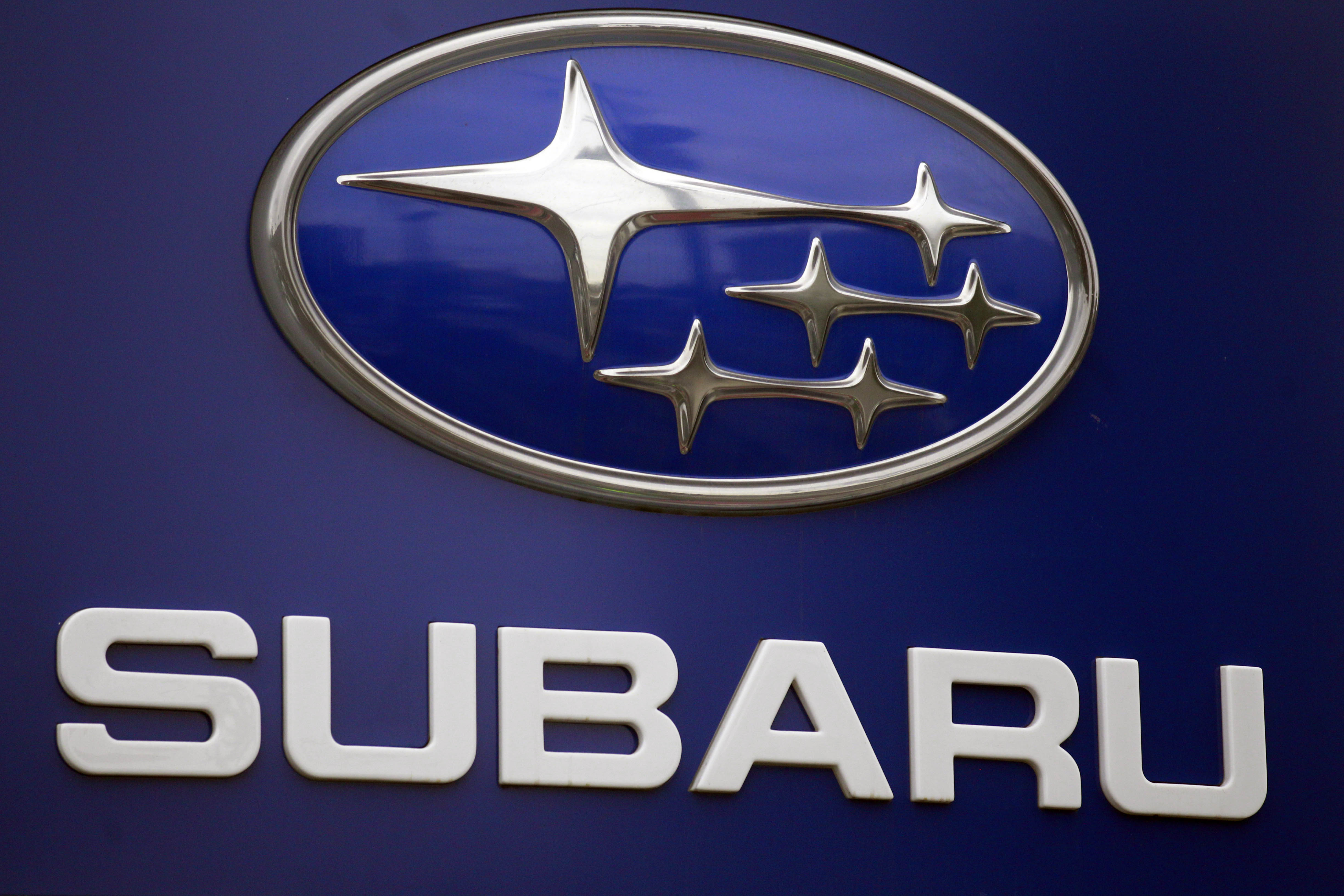 FILE - In this Aug. 31, 2011, file photo, a Subaru logo is displayed on a sign at a dealer's lot, in Portland, Ore. Subaru is recalling more than 660,000 cars and SUVs because the brake lines can rust and leak fluid, and that can cause longer stopping distances. For about half the vehicles, it's the second recall for the same problem. (AP Photo/Rick Bowmer, File)
