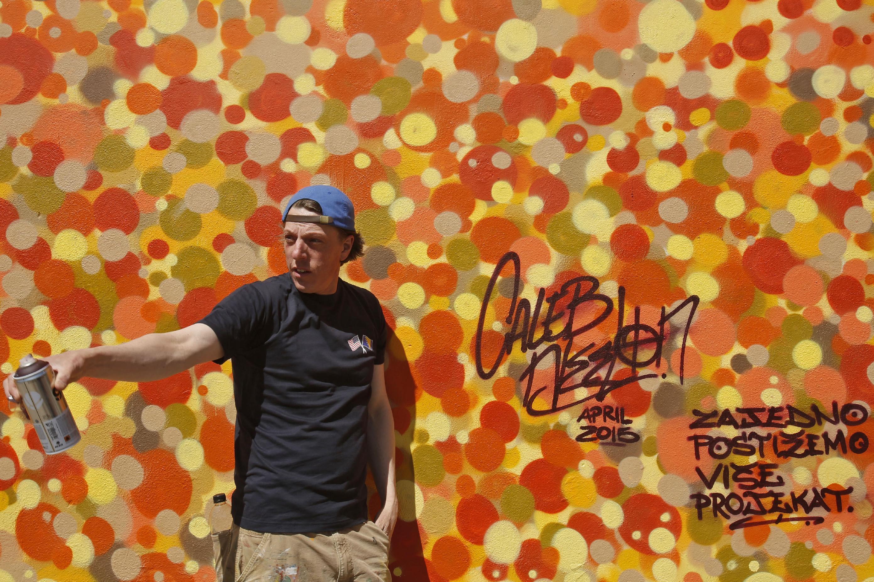 US artist unites divided Bosnian youths to make street art