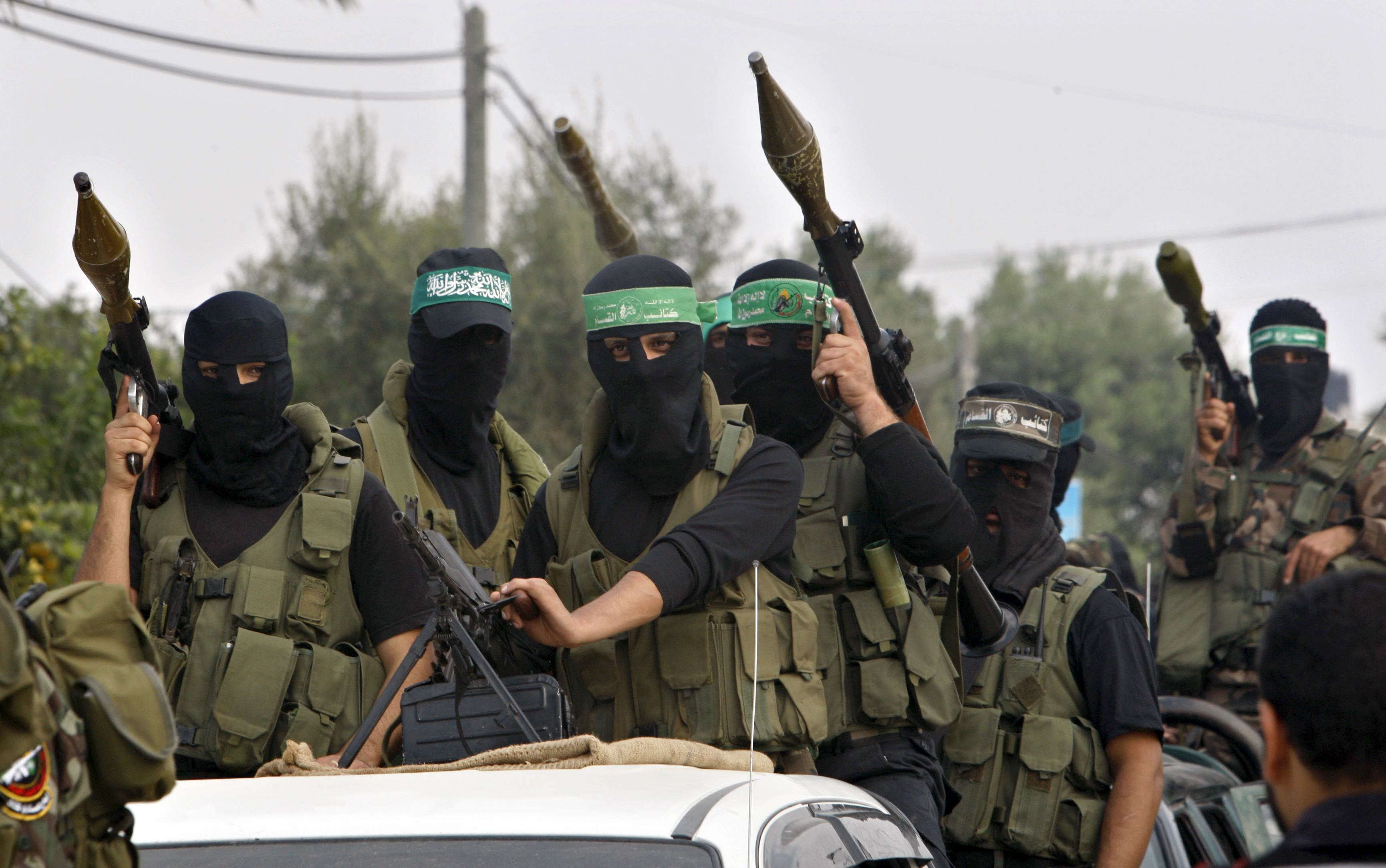 Palestinian militants of the Izzedine Al-Qassam Brigades, the armed wing of Hamas, attend funerals of five Hamas militants in Mugharka village, central Gaza Strip, Thursday, Nov. 22, 2012. Five Hamas militants were killed in an Israeli air strike yesterday, Palestinian health officials said. (AP Photo/Adel Hana)