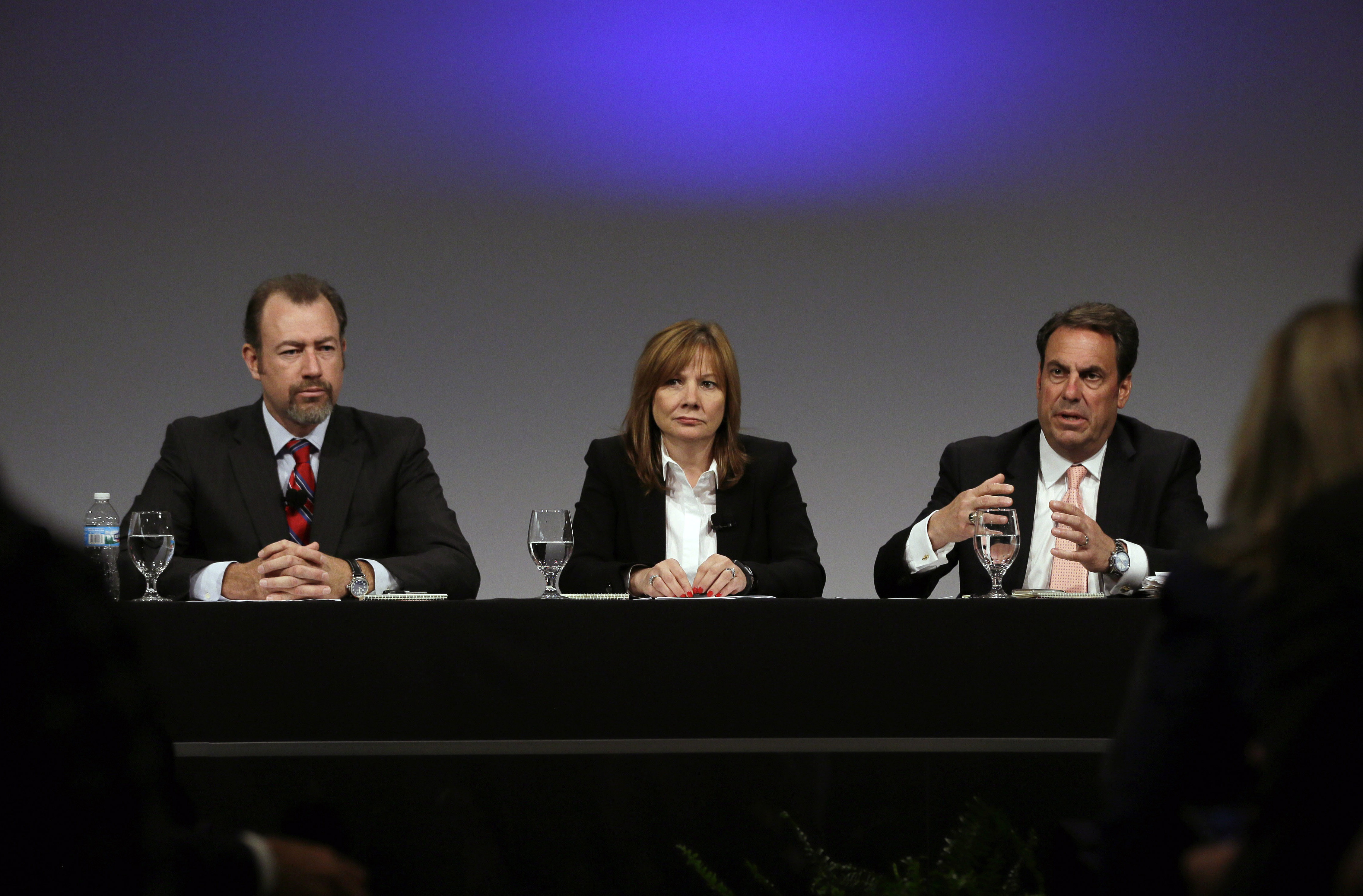 General Motors President Dan Ammann, left, CEO Mary Barra, and Executive Vice President Mark Reuss -Prosecutors' case against GM focuses on misleading statements