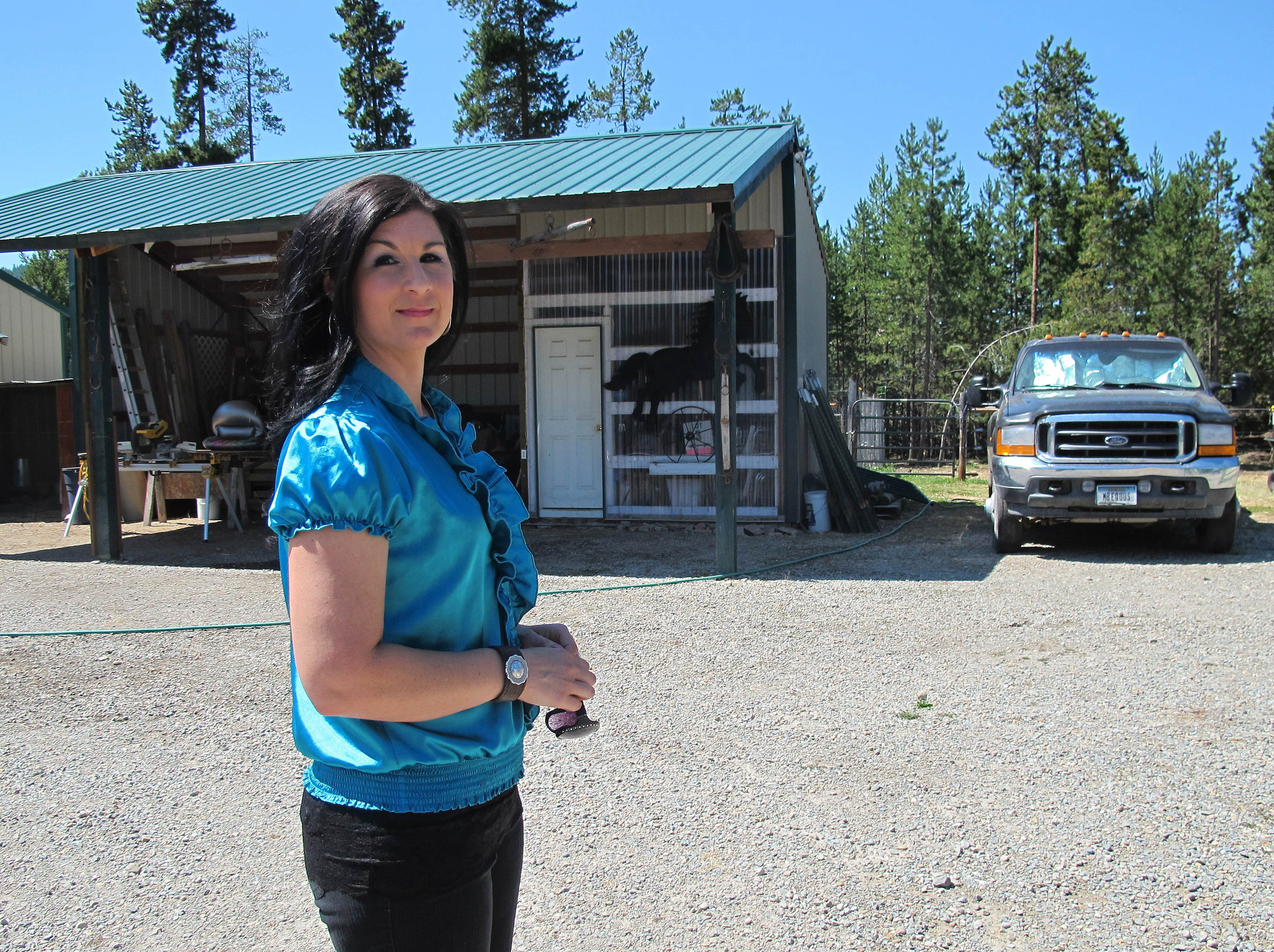 In this photo taken Aug. 7, 2012, Sara Weaver stands outside her horse ranch near Kalispell, Mont. Weaver has finally forgiven the federal agents who 20 years ago shot her mother and younger brother to death during the siege at Idaho's Ruby Ridge. (AP Photo/Nicholas K. Geranios)