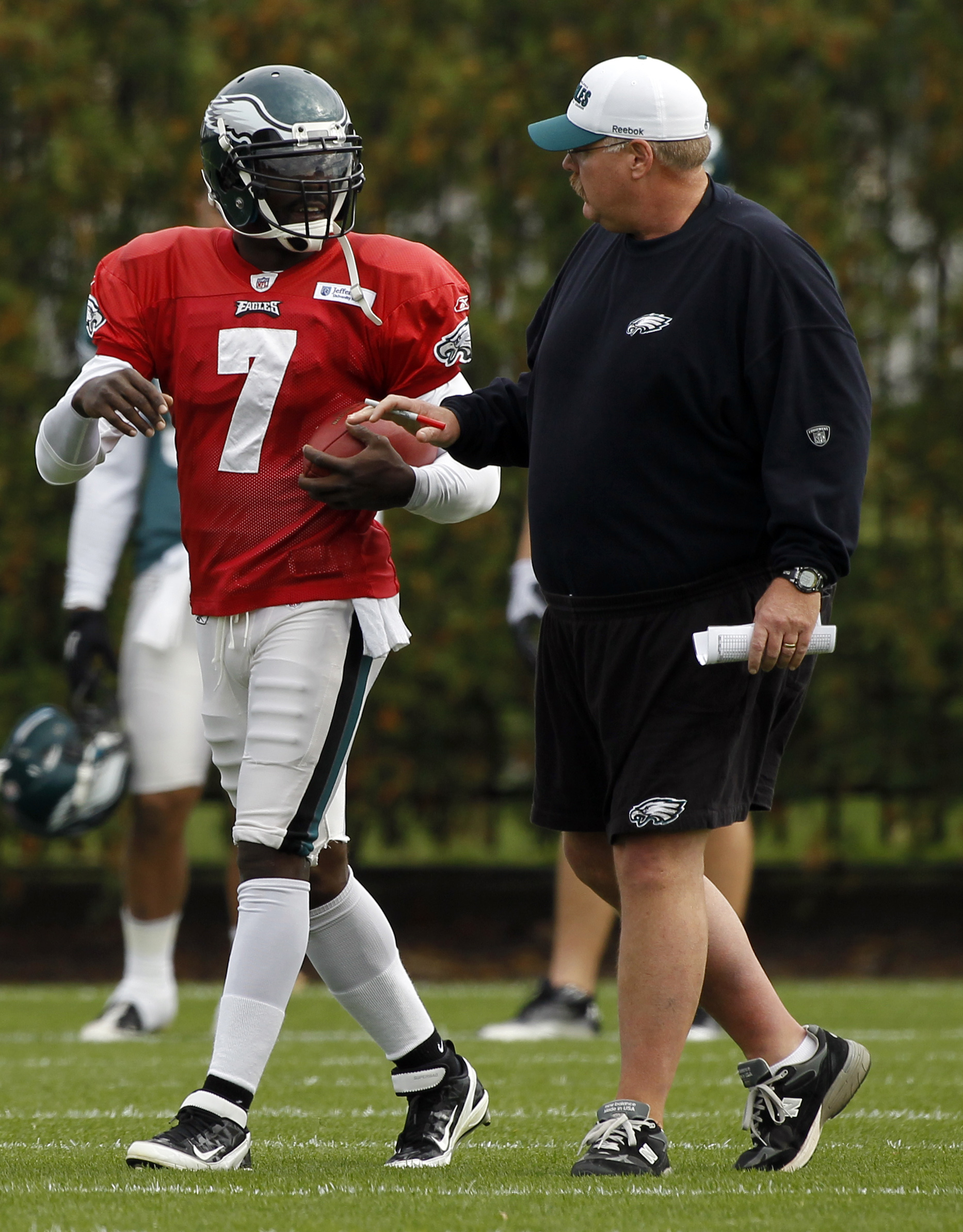 Michael Vick and Andy Reid reportedly worked out their issues. (AP)