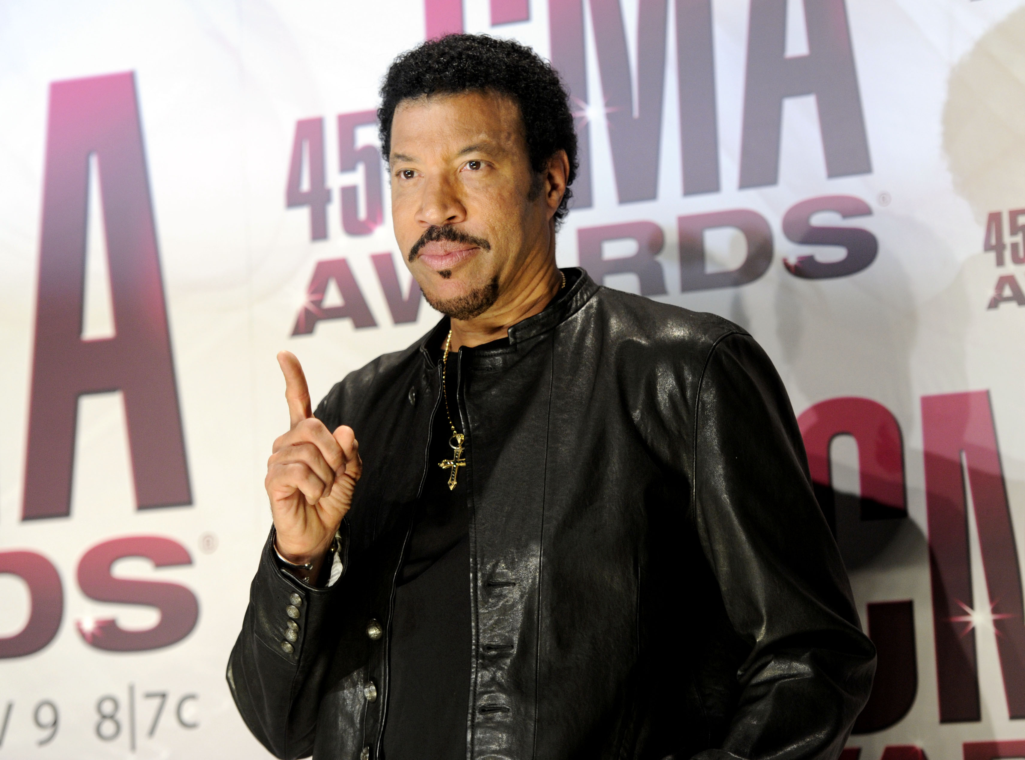 Lionel Richie poses backstage at the 45th Annual CMA Awards in Nashville, Tenn., on Wednesday, Nov. 9, 2011. (AP Photo/Evan Agostini)