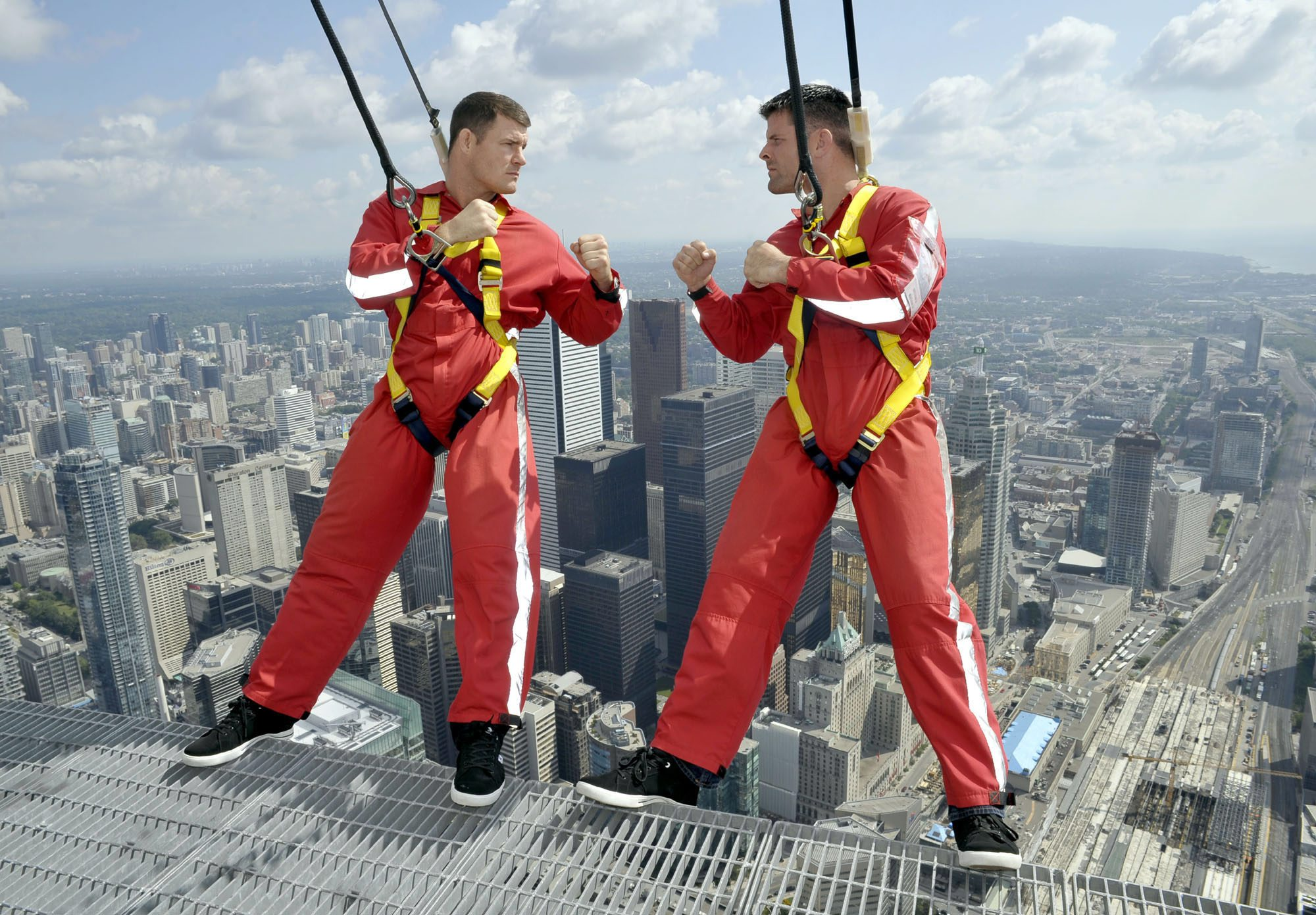 Michael Bisping and Brian Stann hang off the CN Tower's EdgeWalk in Toronto to promote their fight. (AP)