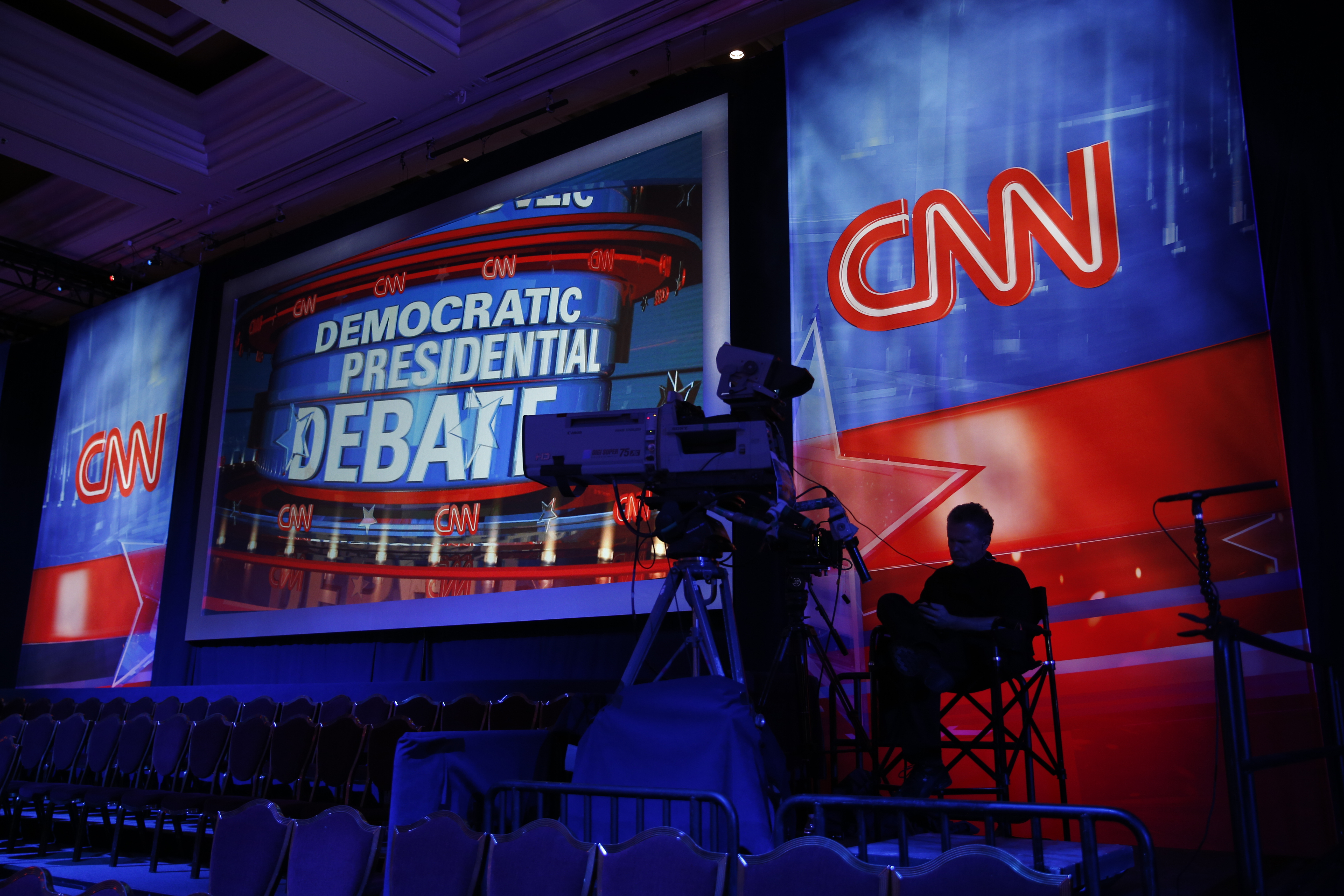 Clinton seeks to move past email woes in Democratic debate