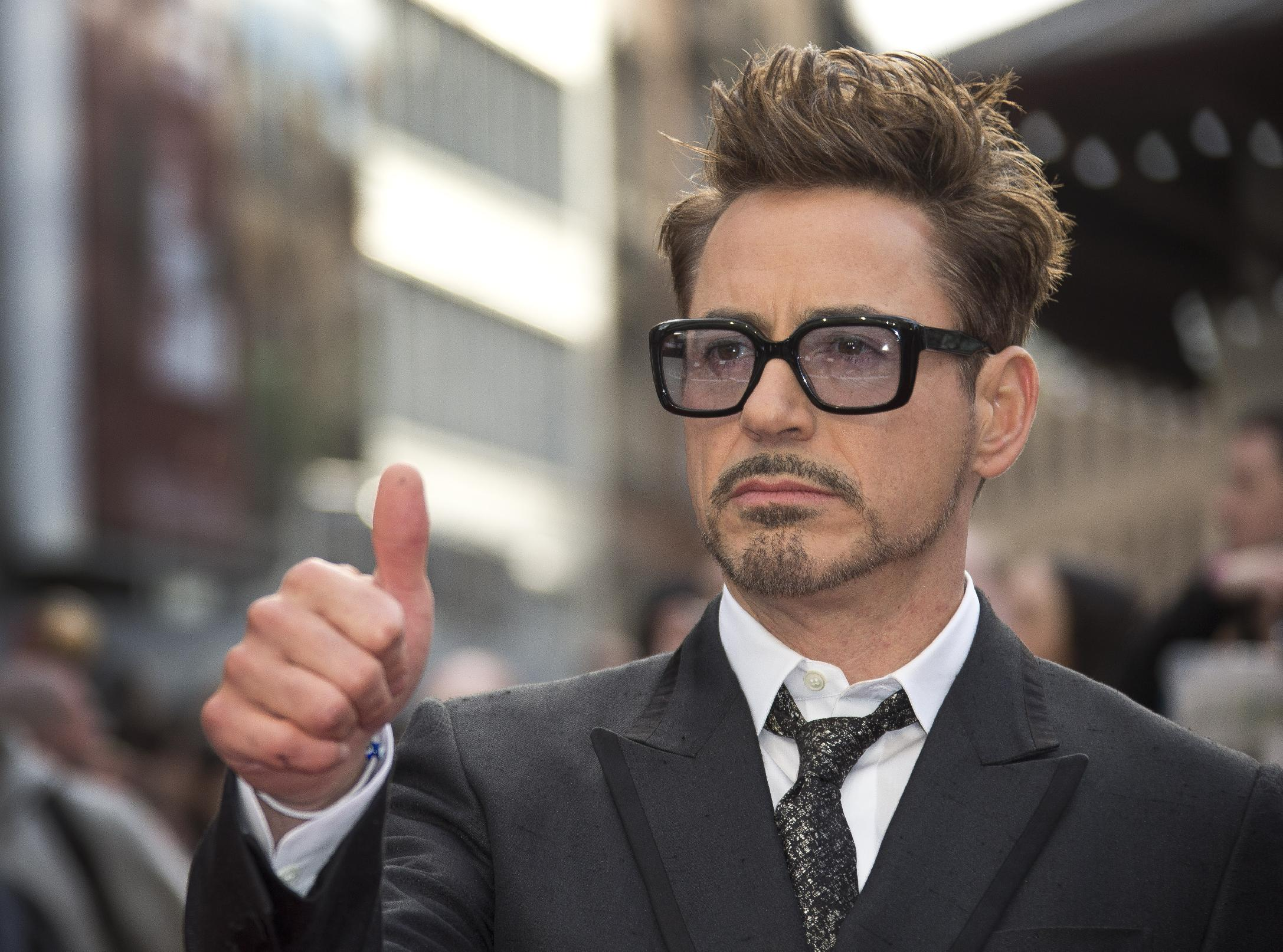 "FILE - This April 18, 2013 photo shows actor Robert Downey Jr at the UK premiere of ""Iron Man 3,"" in central London. Marvel announced Thursday, June 20, that the actor will reprise his role as Iron Man/Tony Stark for both ""The Avengers 2"" and ""The Avengers 3."" Downey Jr. has played the character in a trilogy of ""Iron Man"" films, as well as the first ""Avengers"" film,"" which made $2.7 billion worldwide. (Photo by Joel Ryan/Invision/AP, file)"