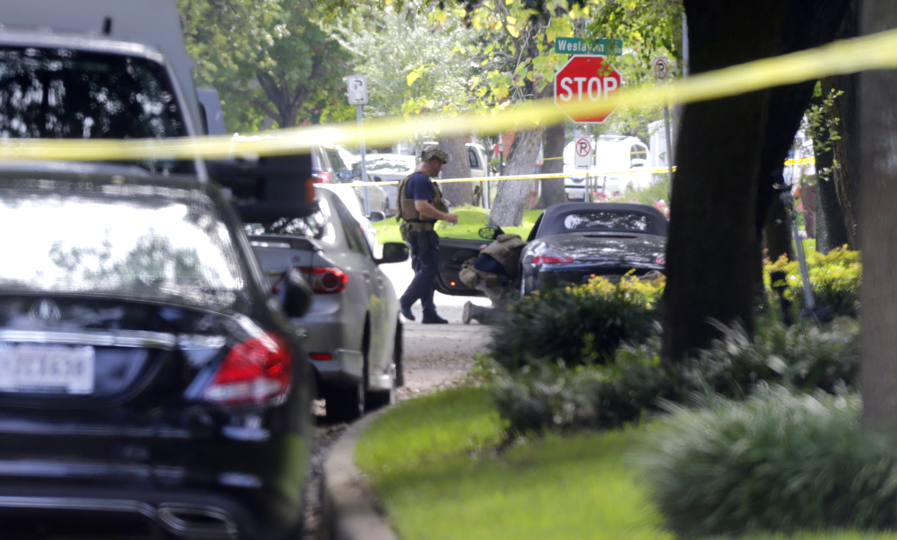 Houston gunman killed after wounding 9 described as reserved
