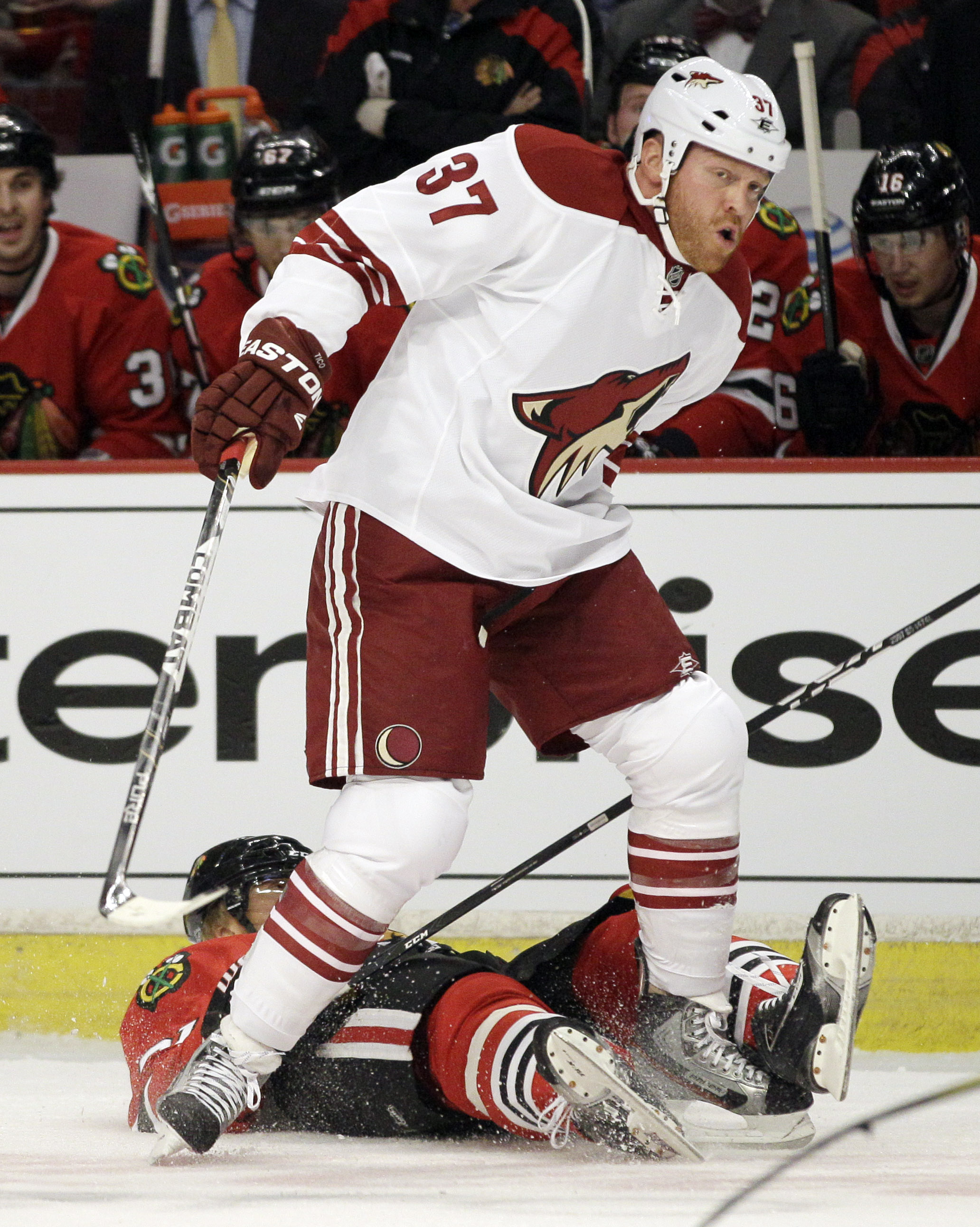 Raffi Torres knocked both himself and Marian Hossa out of the 2012 playoffs with this hit. (AP)
