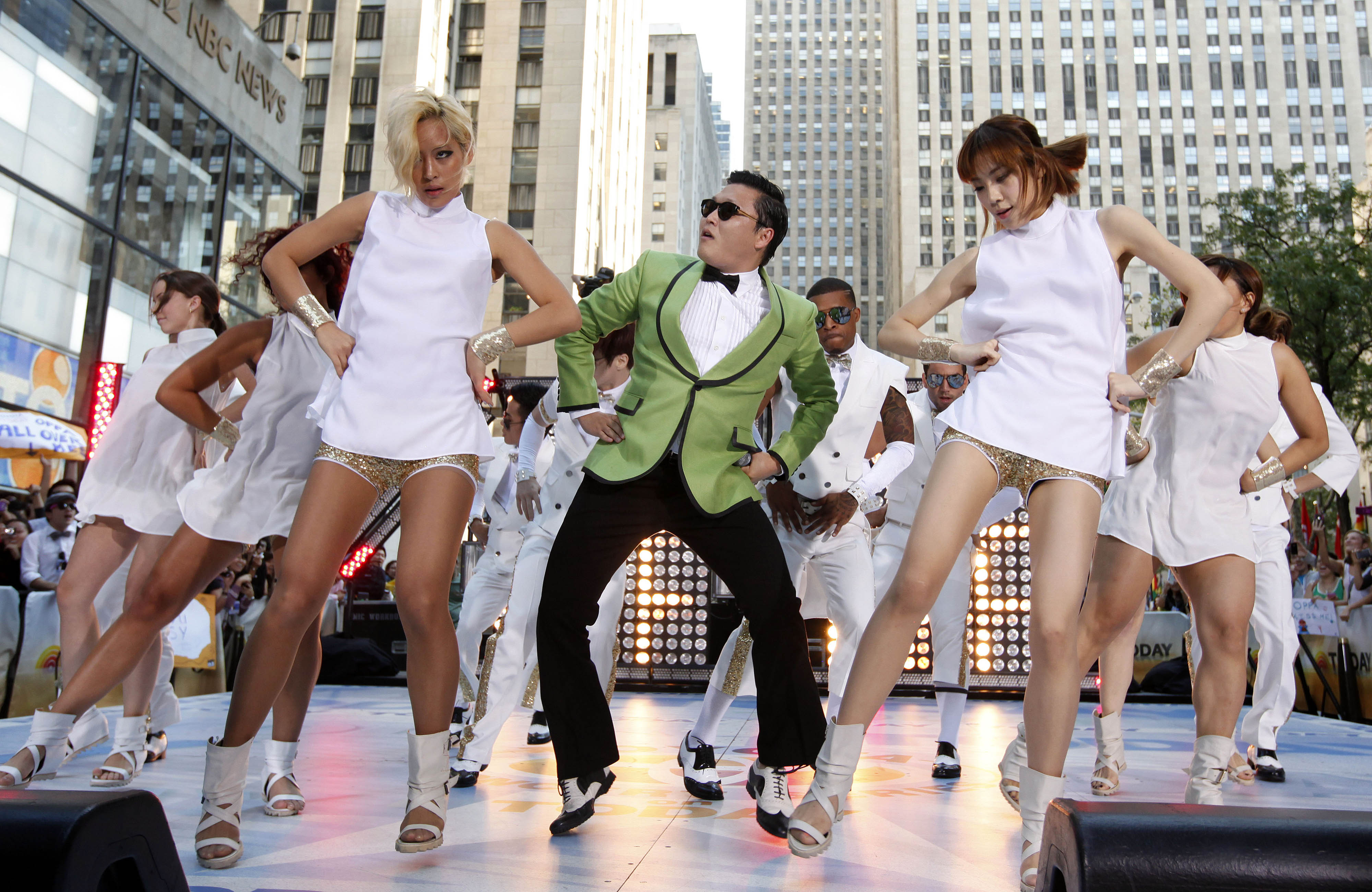 In this photo taken on Sept. 14, 2012, South Korean rapper PSY performs his massive K-pop hit