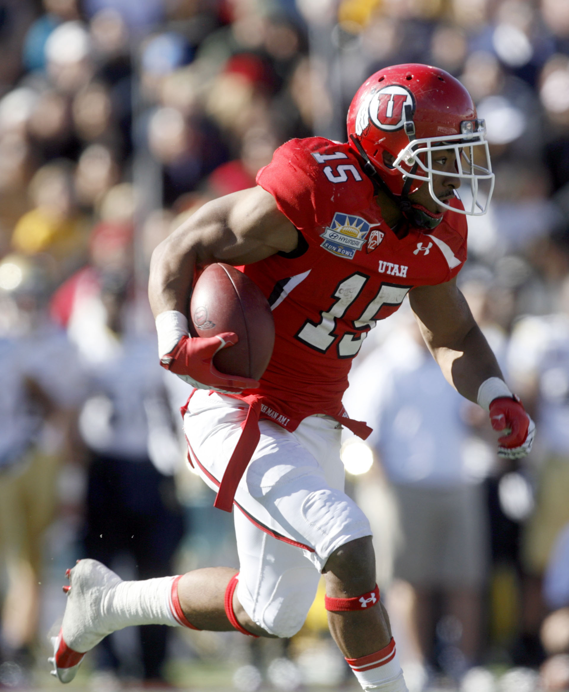 John White set a Utah single-season rushing record in 2011, his first season with the Utes. (AP)