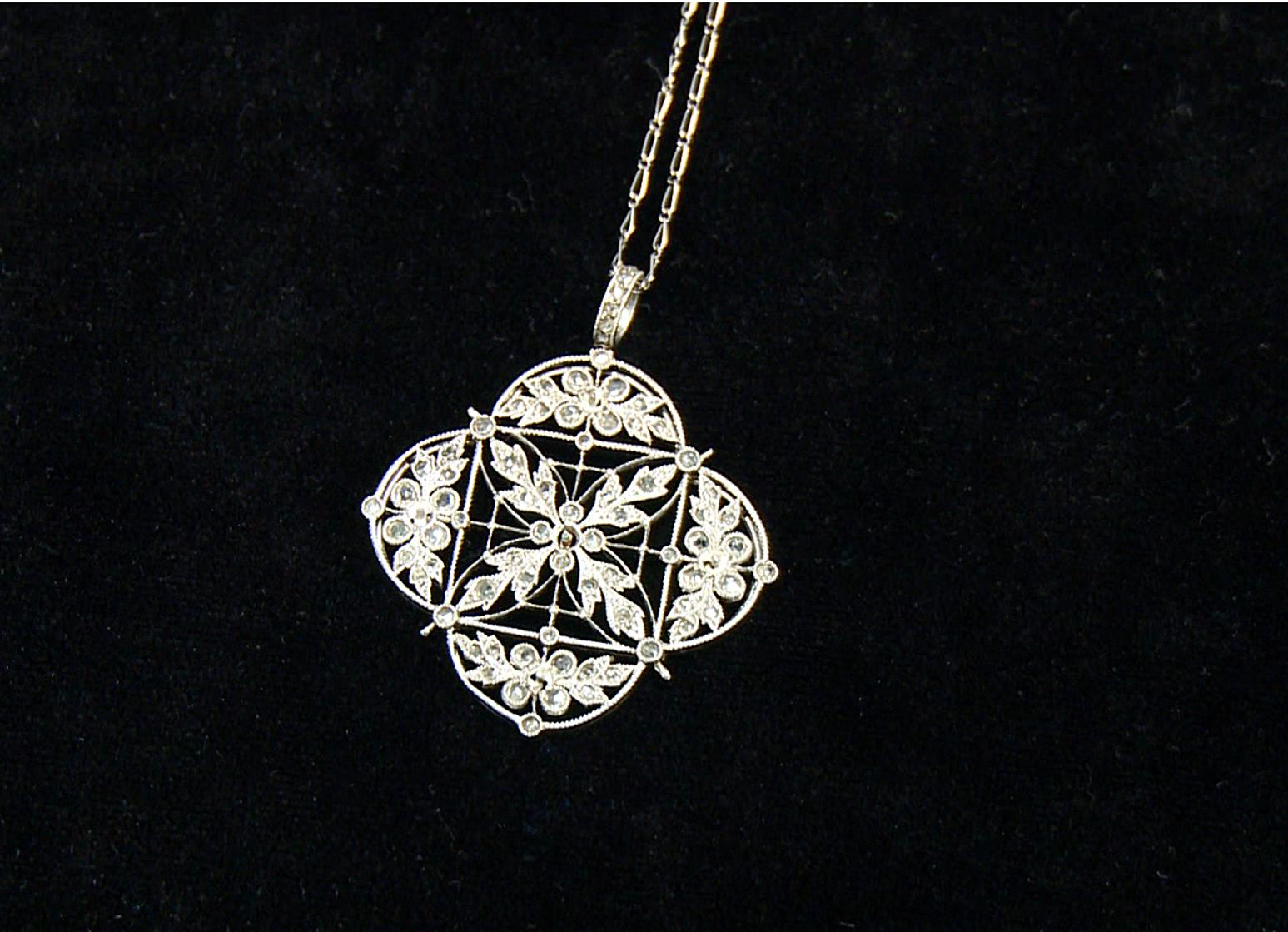 A platinum and diamond necklace recovered from the Titanic is seen in an image made from video. This piece and others begin a three-city tour in Atlanta on Friday, Nov. 16, 2012 and represent the largest collection of jewelry ever on display marking the 100th anniversary of the sinking of the ship. Although single pieces of jewelry have been on display at one or more permanent and traveling exhibits sponsored by Premier Exhibitions Inc., their Atlanta debut is the first time the majority of the collection has been available to the public. (AP Photo/Jpohnny Clark)