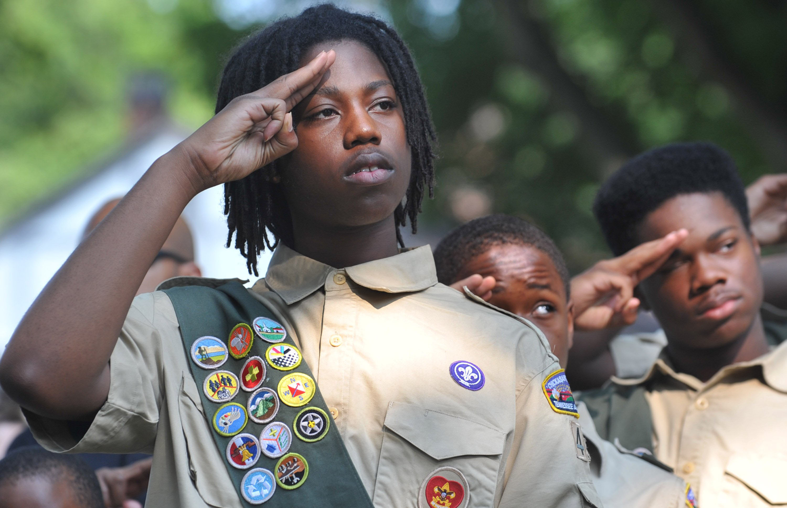 Stevon Spears, 17 and members of Boy Scout Troop 445 salute the American flag during the Memorial Day observance ceremony at the Memphis National Cemetery in Memphis, Tenn., on Saturday, May 26, 2012. (Chris Desmond/The Commercial Appeal)
