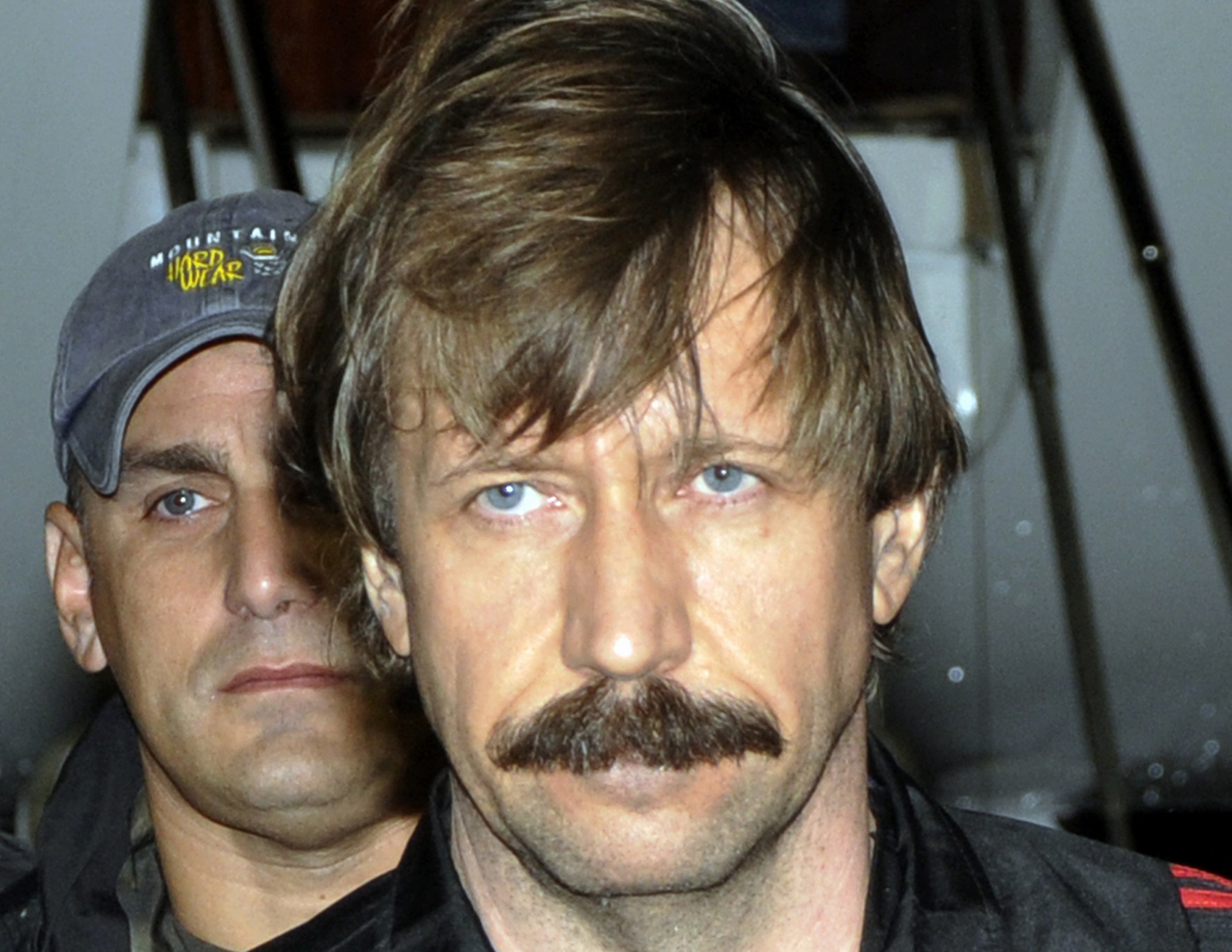FILE - This Tuesday Nov. 16, 2010 file photo provided by the Drug Enforcement Administration shows Russian arms trafficker Viktor Bout in U.S. custody after being flown from Bangkok to New York in a chartered U.S. plane. The ex-Soviet officer turned arms dealer faces a mandatory minimum of 25 years in prison at sentencing Thursday, April 5, 2012. (AP Photo/Drug Enforcement Administration, File)