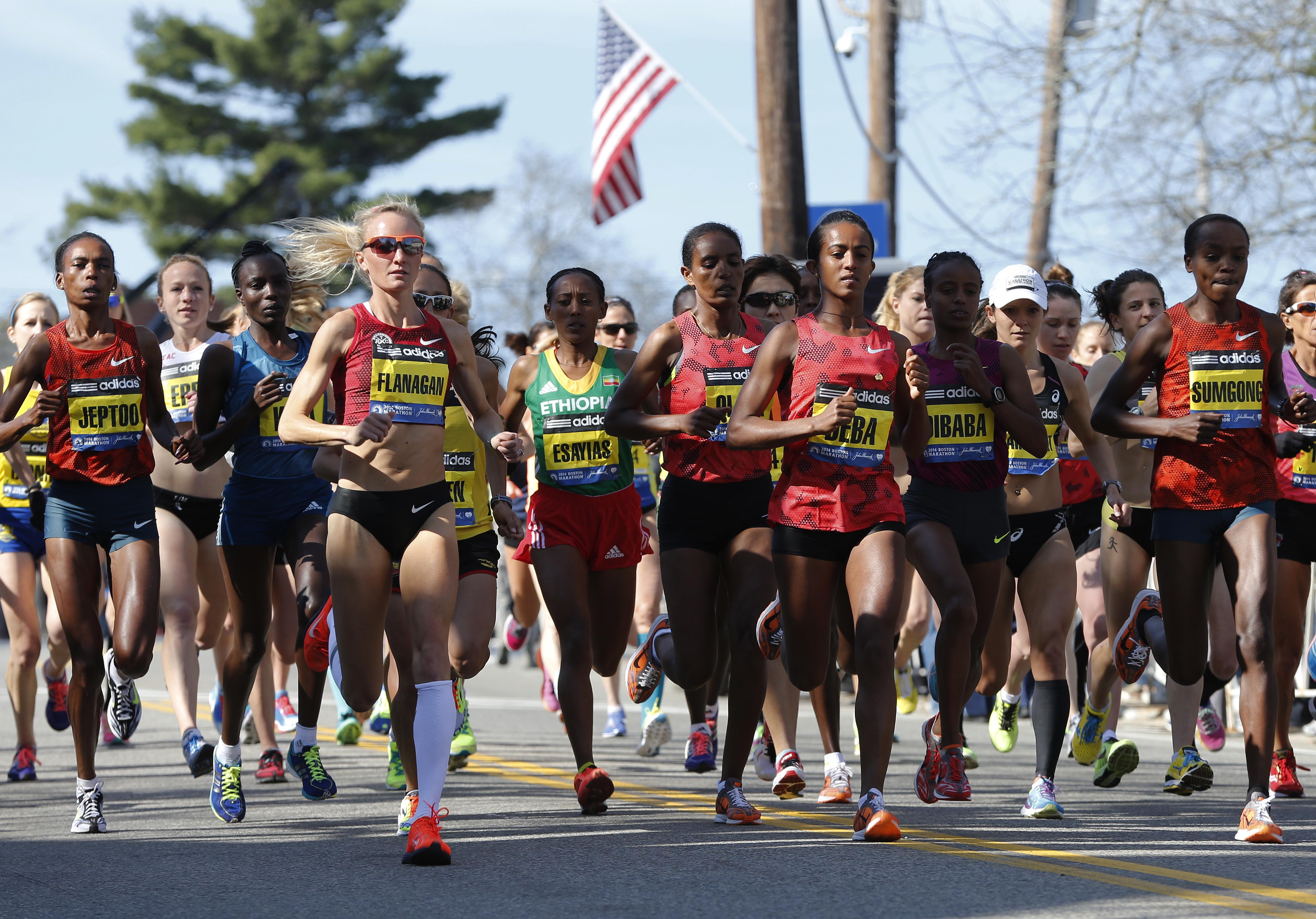 From left, Rita Jeptoo, Shalane Flanagan, Yeshi Esayias, Buzunesh Deba, Mare Dibaba, and Jemima Jelagat Sumgong run shortly after the start in the women's division of the 118th Boston Marathon Monday, April 21, 2014 in Hopkinton, Mass. (AP Photo/Michael Dwyer)
