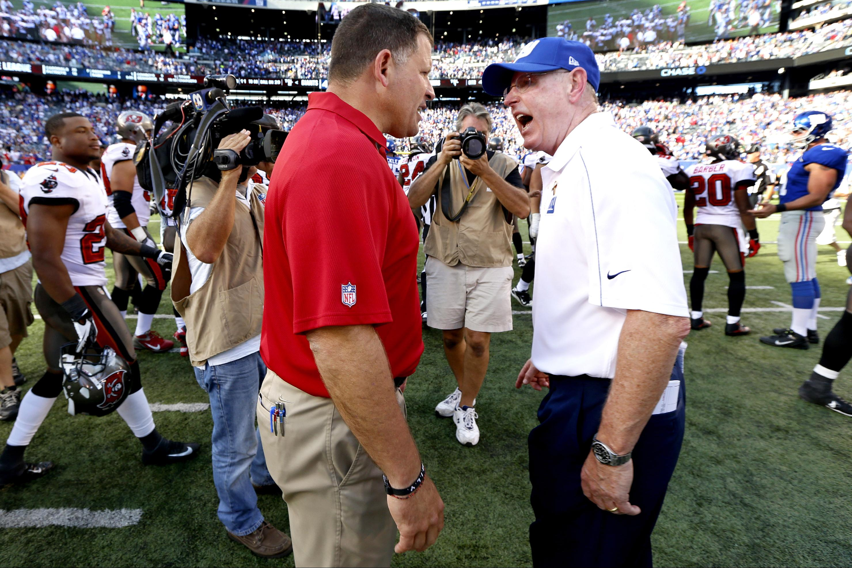 Greg Schiano, left, and Tom Coughlin exchange words after Sunday's Bucs-Giants game. (AP)