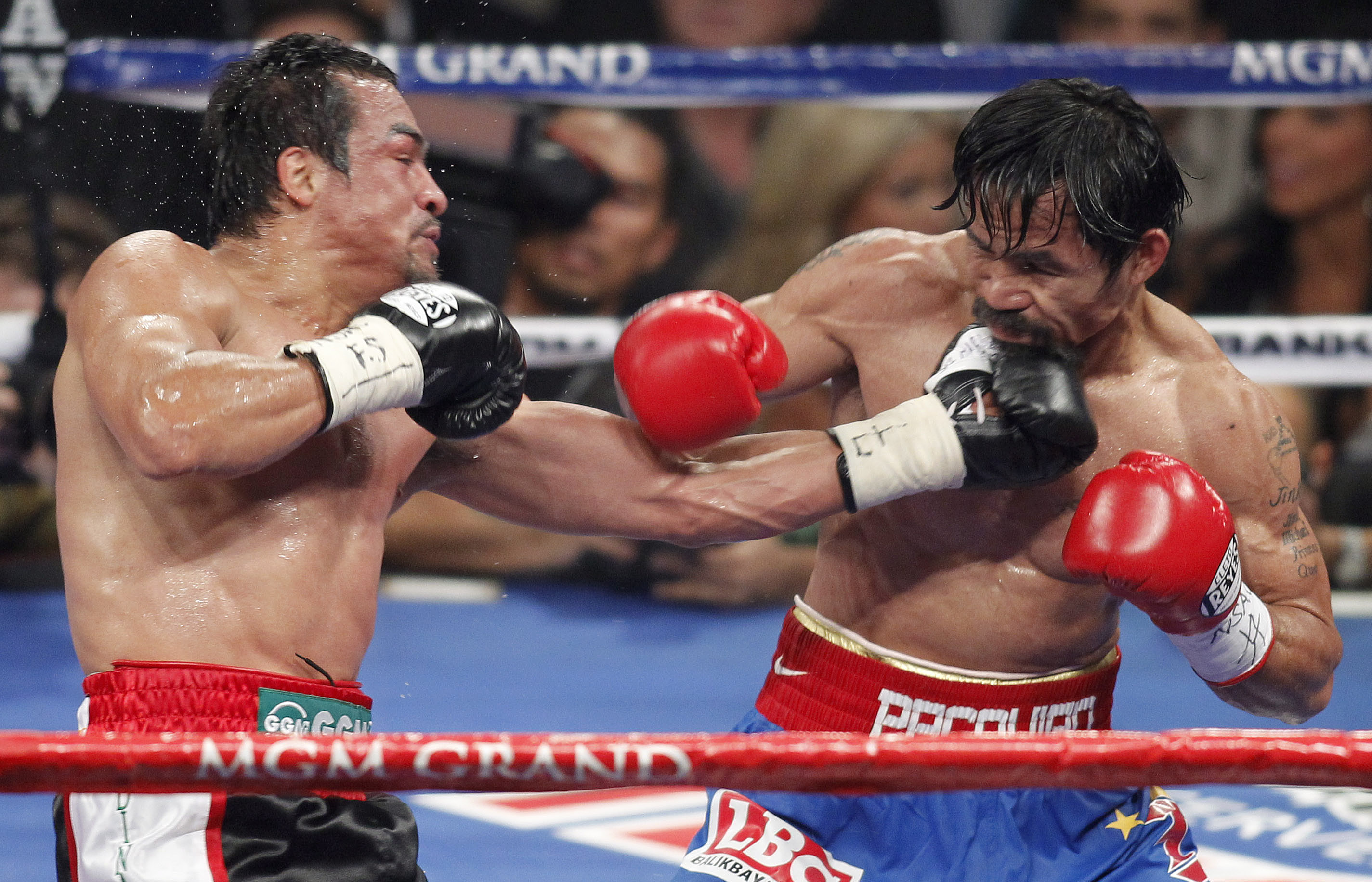 Manny Pacquiao and Juan Manuel Marquez could fight for a fourth time on Dec. 8. (AP)