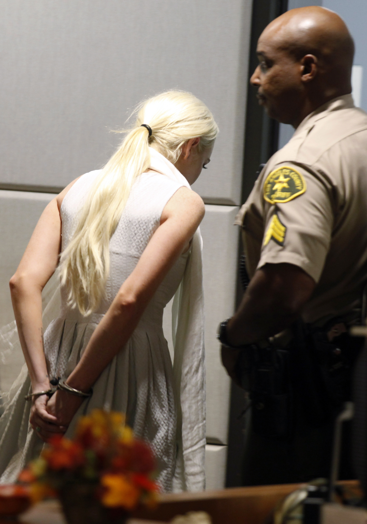 Lindsay Lohan is taken into custody by Los Angeles Country sheriff deputies after a judge found her in violation of probation Wednesday, Oct. 19, 2011, in Los Angeles. (AP Photo/Mark Boster, Pool)