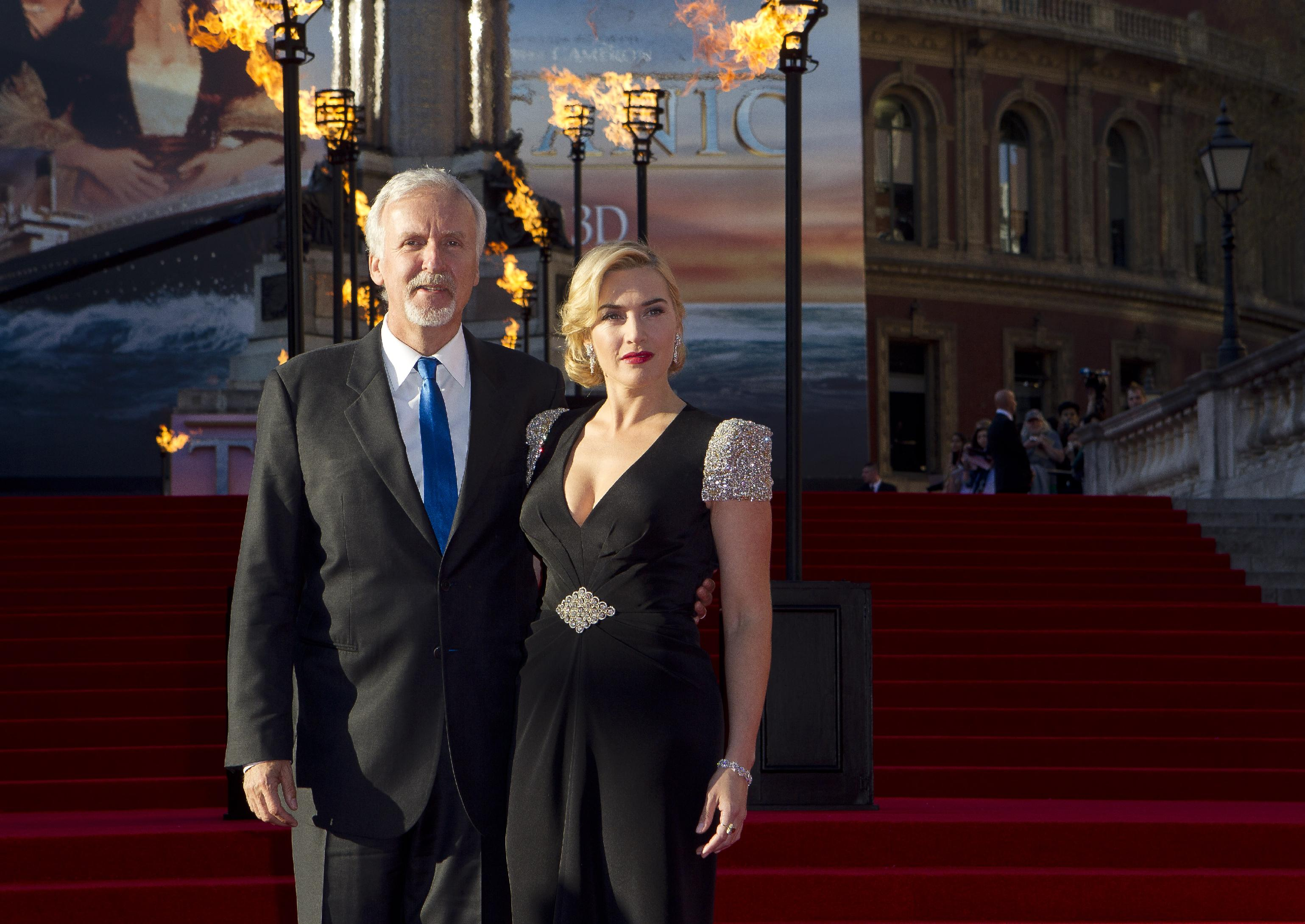 Director James Cameron, left, and actress Kate Winslet arrive at the 'Titanic 3D' UK film premiere at the Royal Albert Hall in Kensington, West London, Tuesday, March 27, 2012. The re-launch of the Titanic 3D version comes 15 years after the film was a huge box office hit. (AP Photo/Joel Ryan)