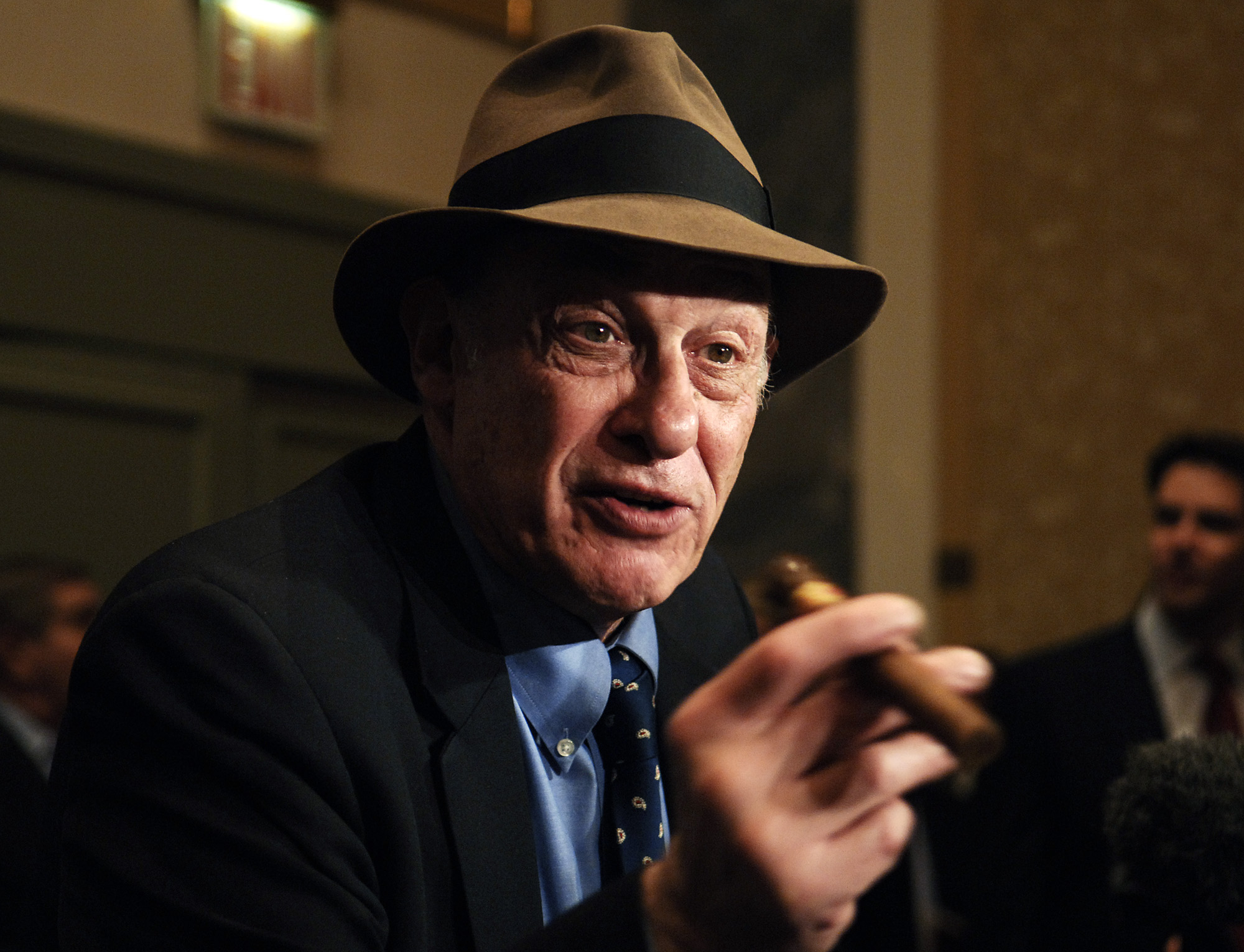 In this file photo taken Oct. 28, 2005, boxing historian Bert Sugar is seen at the Friars Club Roast in New York. Sugar, known for his fedora and cigar, has died. Jennifer Frawley, Sugar's daughter, said cardiac arrest caused his death on Sunday, March 25, 2012. His wife, Suzanne, was by his side when he passed away. (AP Photo/Louis Lanzano, file)