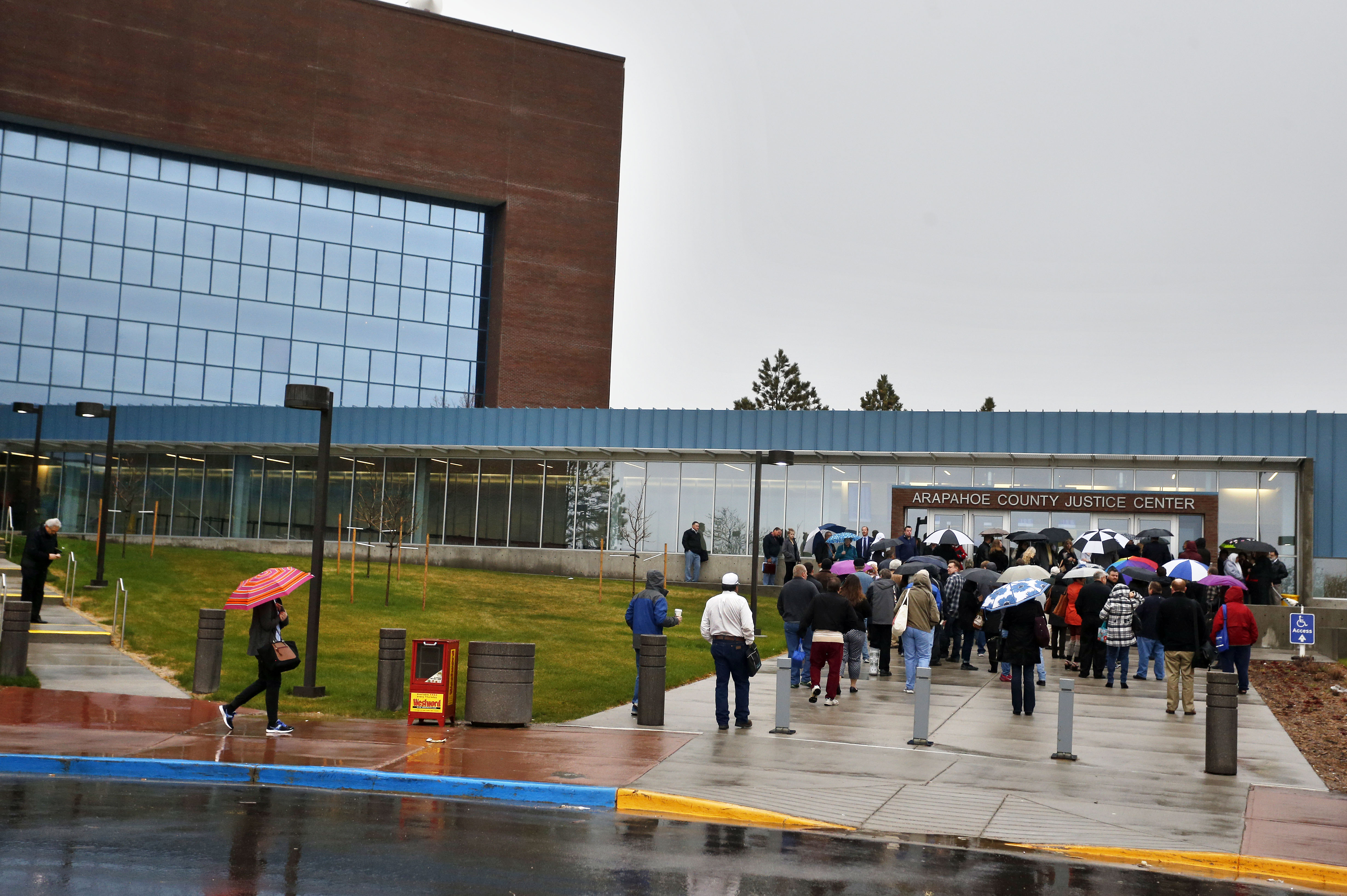 The Latest: Last-minute hearing underway in theater shooting