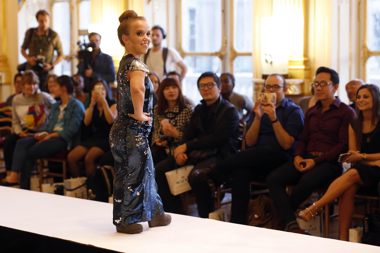 AP PHOTOS: French ministry hosts dwarf fashion show