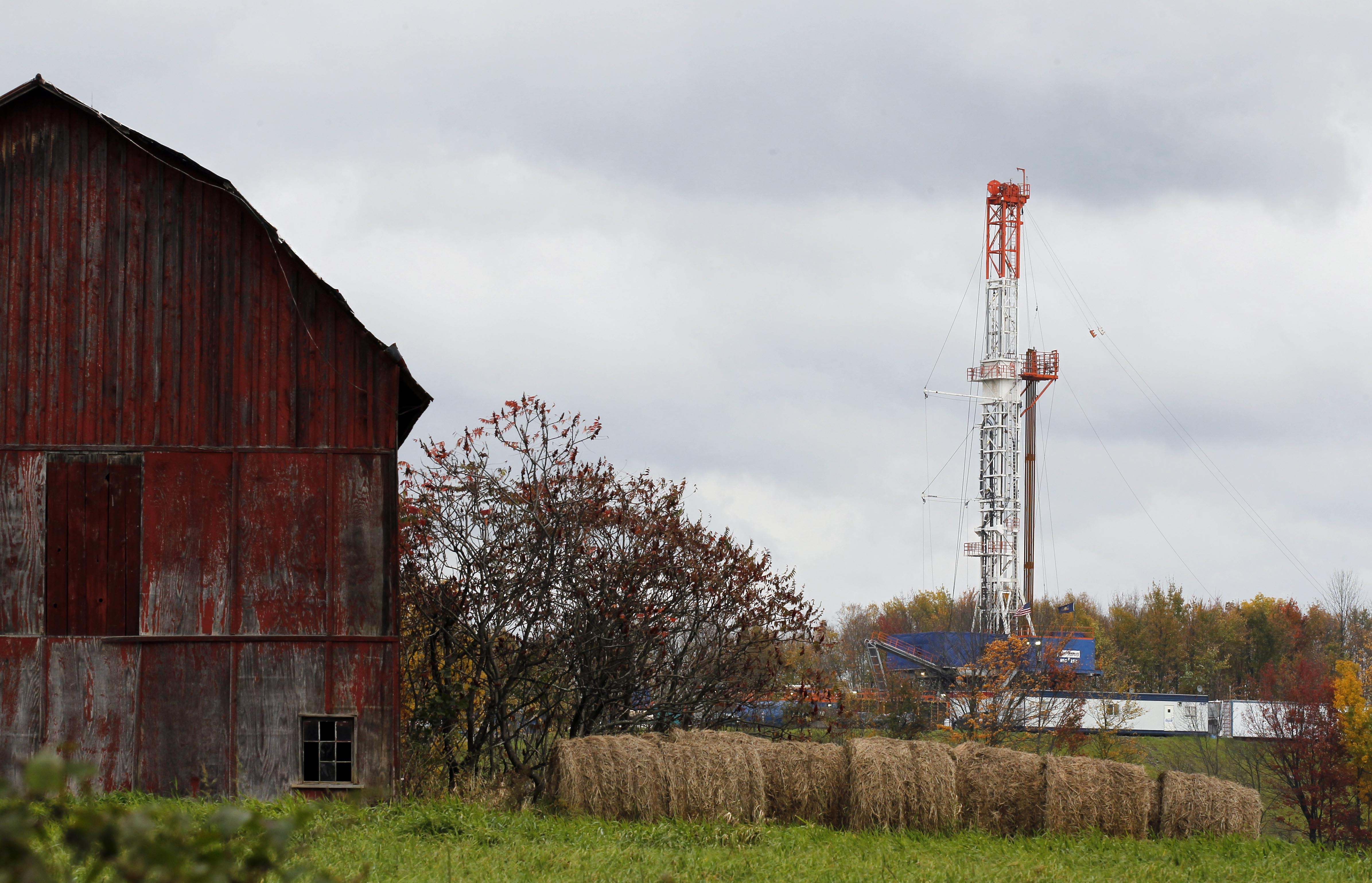 A drilling rig is set up near a barn in Springville, Pa., to tap gas from the giant Marcellus Shale gas field. (AP Photo/Alex Brandon, File)