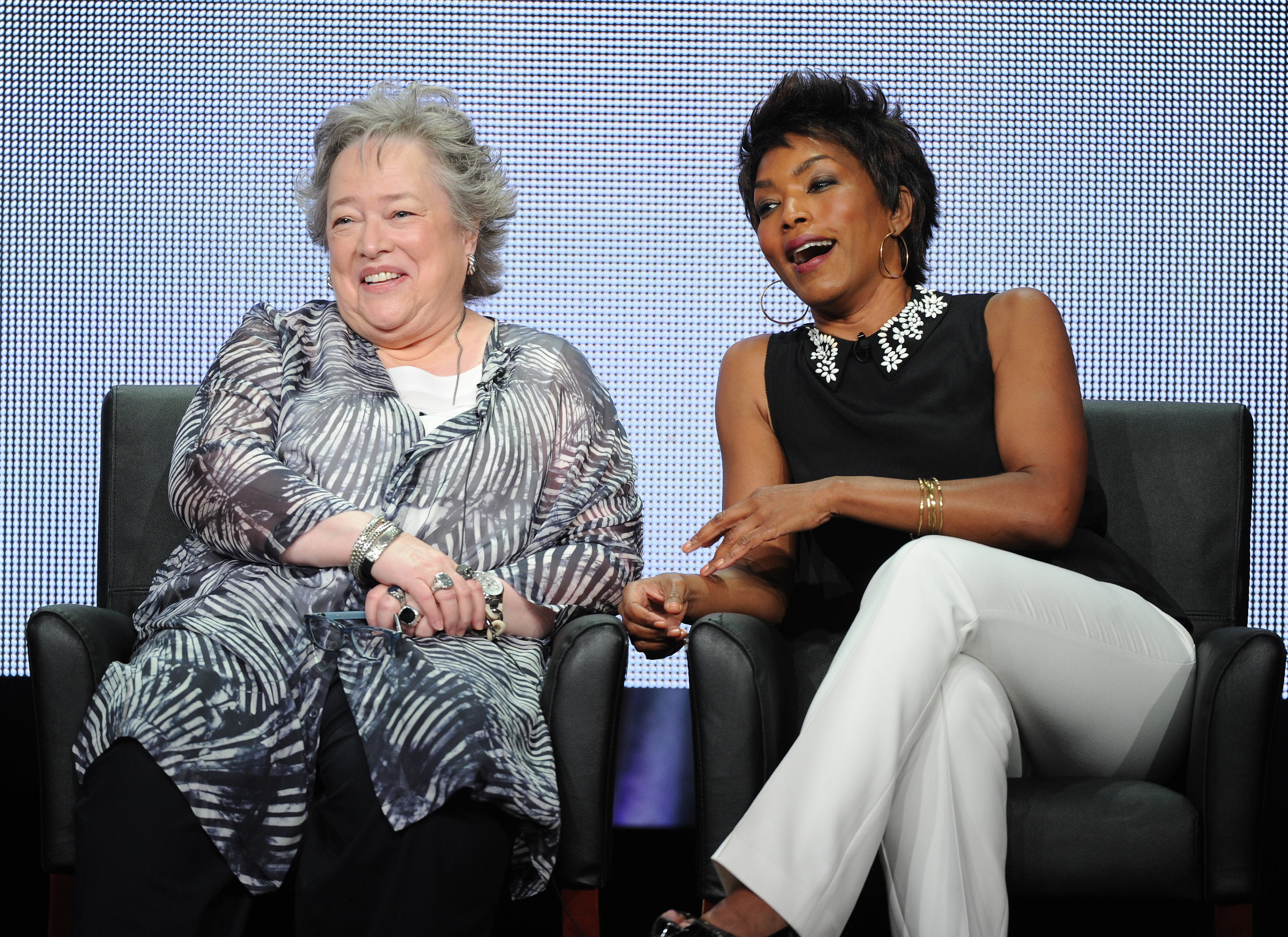 "From left, actors Kathy Bates and Angela Bassett participate in ""American Horror Story: Coven"" panel at the FX 2013 Summer TCA press tour at the Beverly Hilton Hotel on Friday, August 2, 2013 in Beverly Hills, Calif. (Photo by Frank Micelotta/Invision for FX/AP Images)"