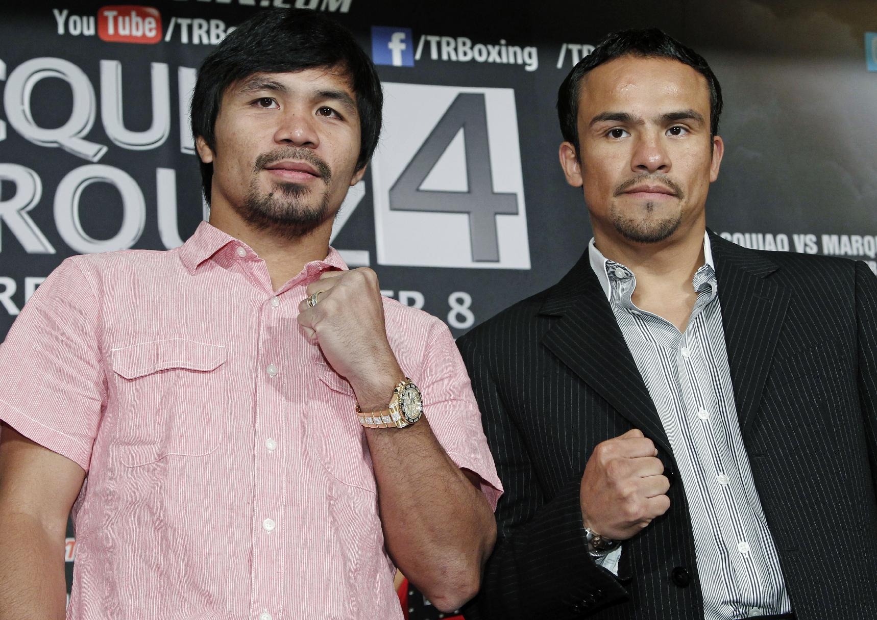 Manny Pacquiao and Juan Manuel Marquez will fight for a fourth time on Dec. 8 in Las Vegas. (AP)