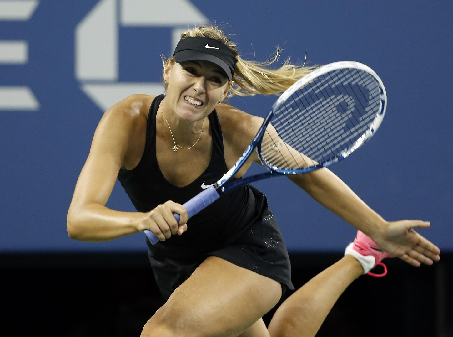 Sharapova gets past Lisicki in 2 sets at US Open