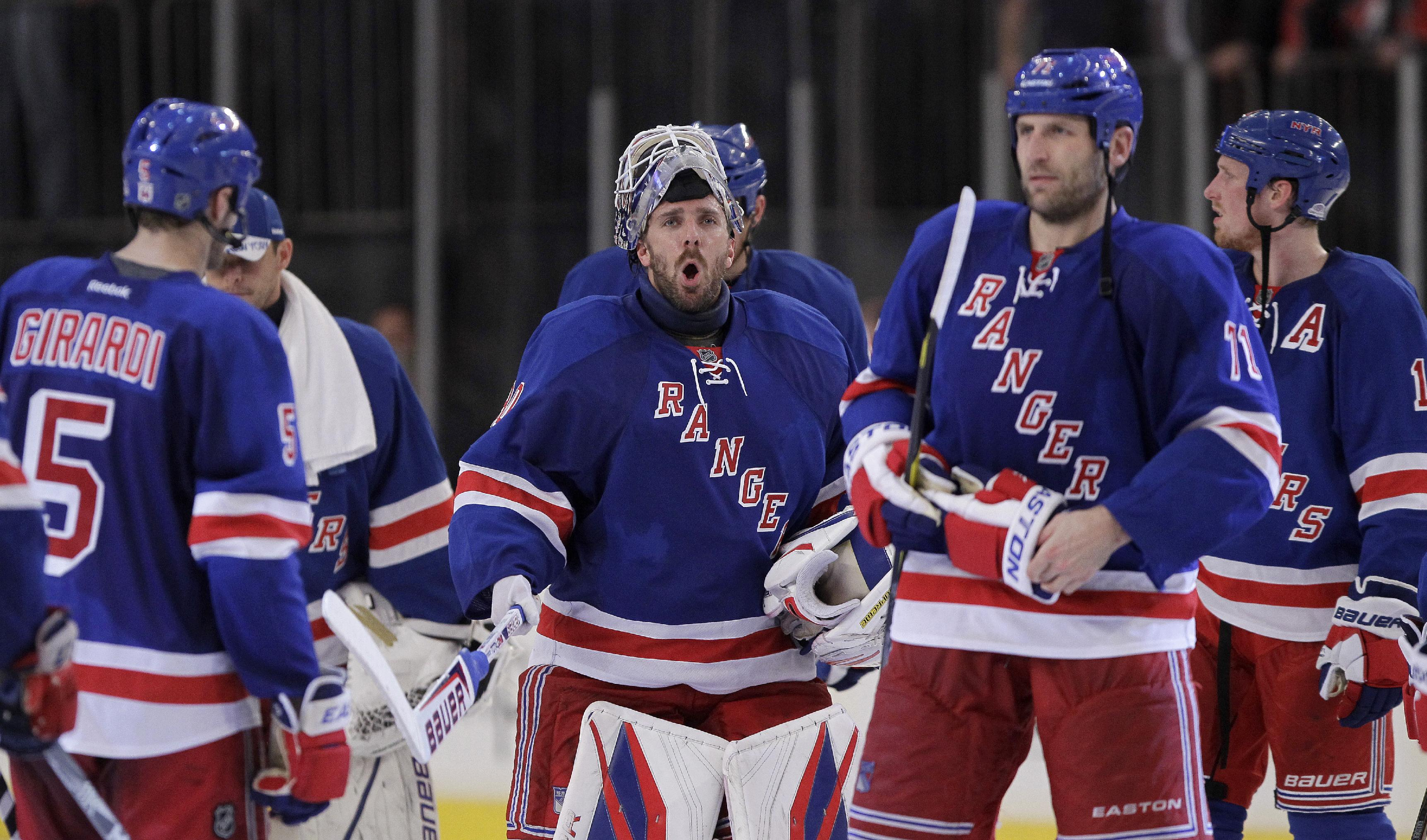 Rangers goalie Henrik Lundqvist celebrates moving on to Round 2. (AP)